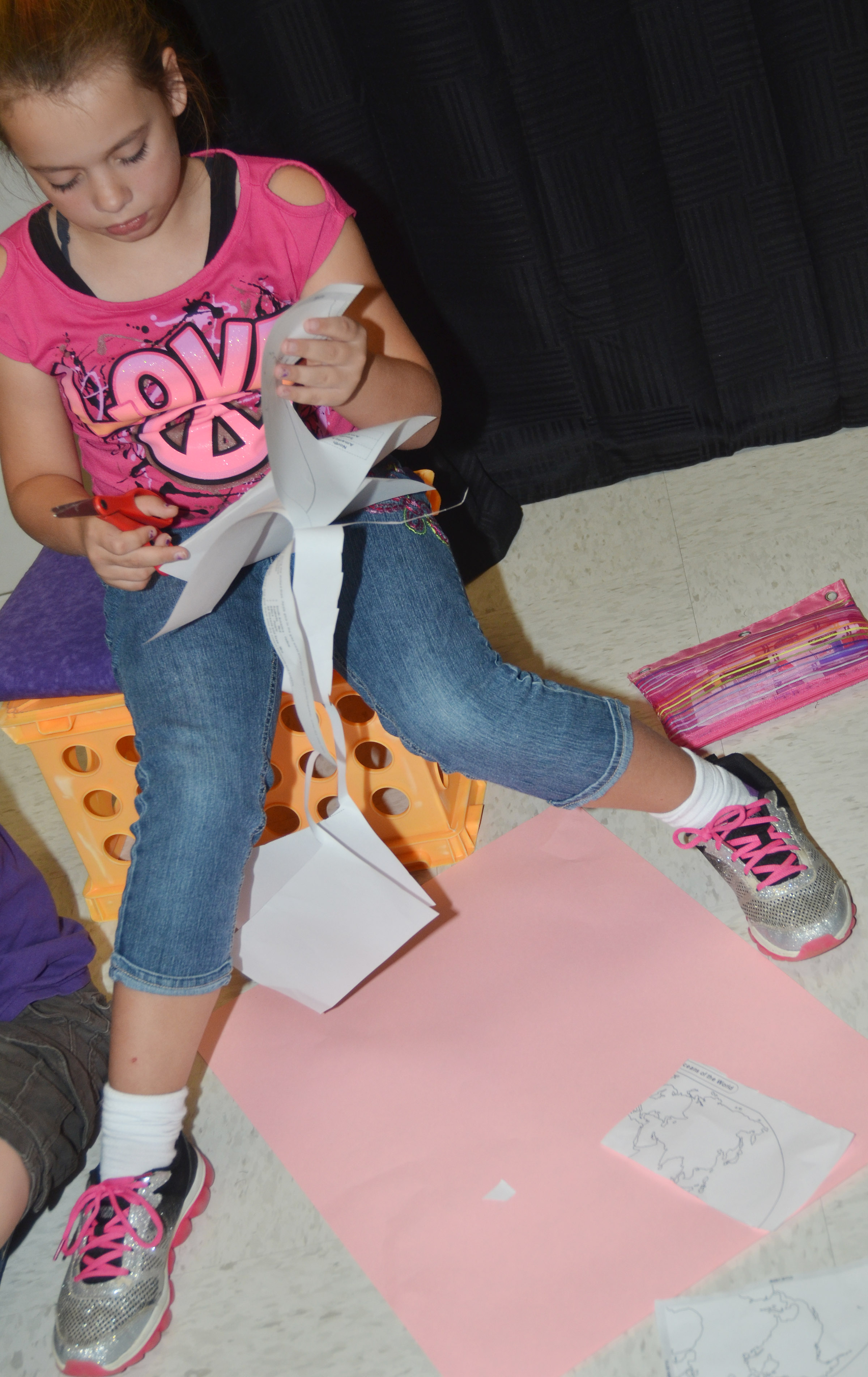 CES third-grader Cadence Burton cuts out her continents to glue on construction paper and then label.