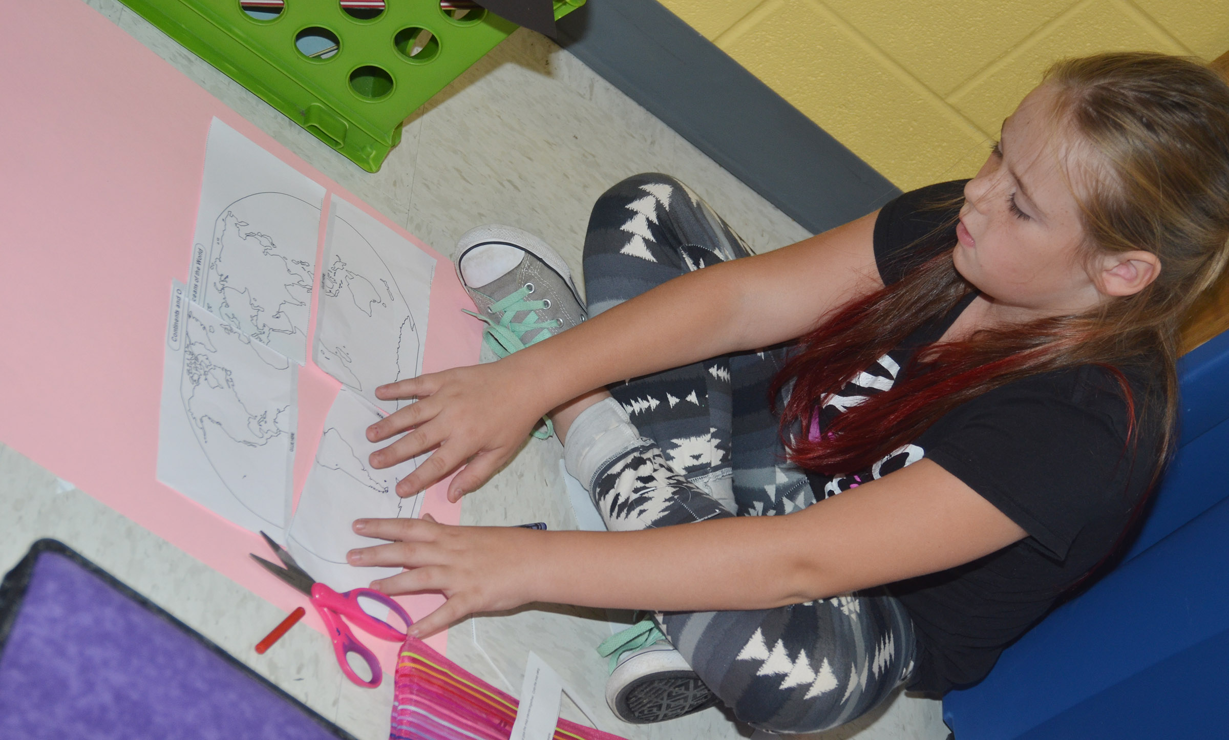 CES third-grader Cayleigh Underwood puts her continents together so she can label them.