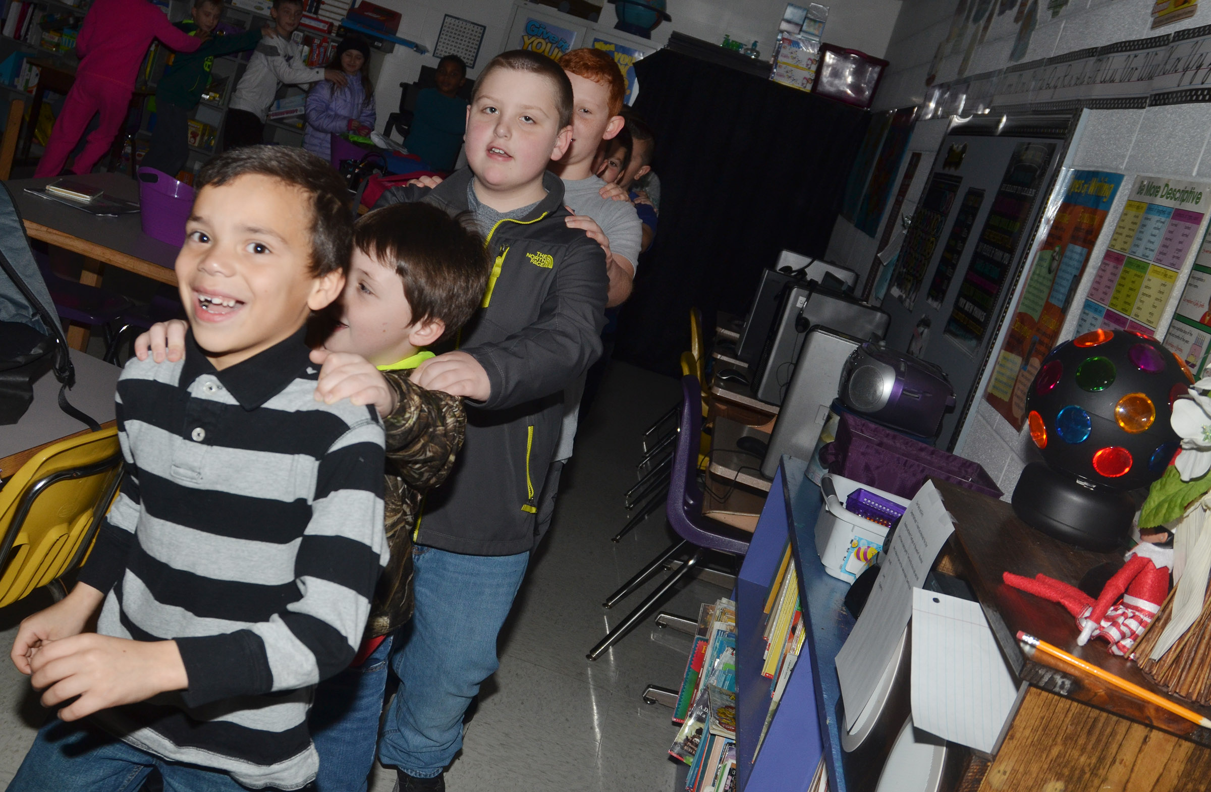 CES third-grader Donnaven Phillips leads his classmates in a conga line during their disco party.