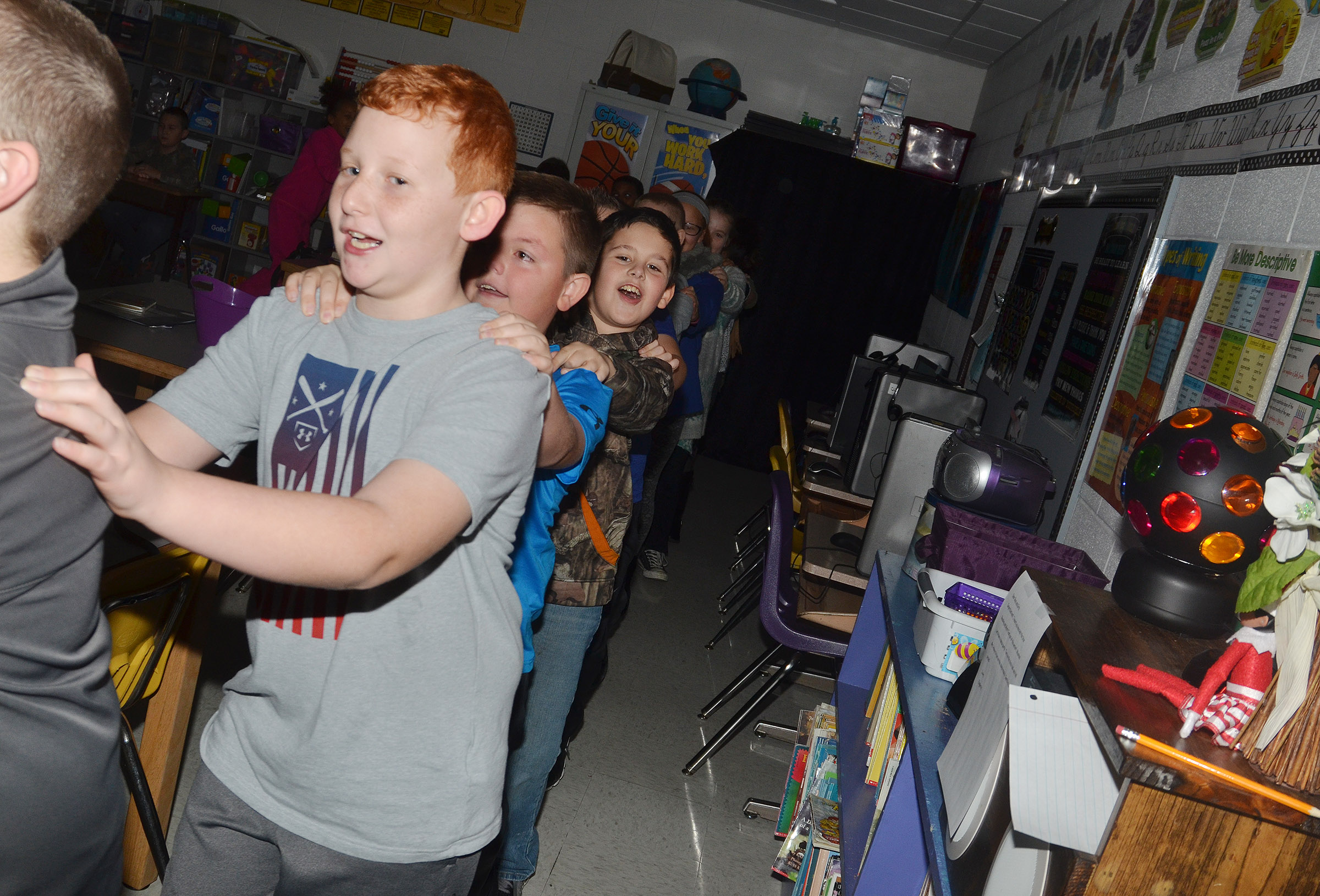 CES third-grader Reece Swafford and his classmates dance in a conga line during their disco party.