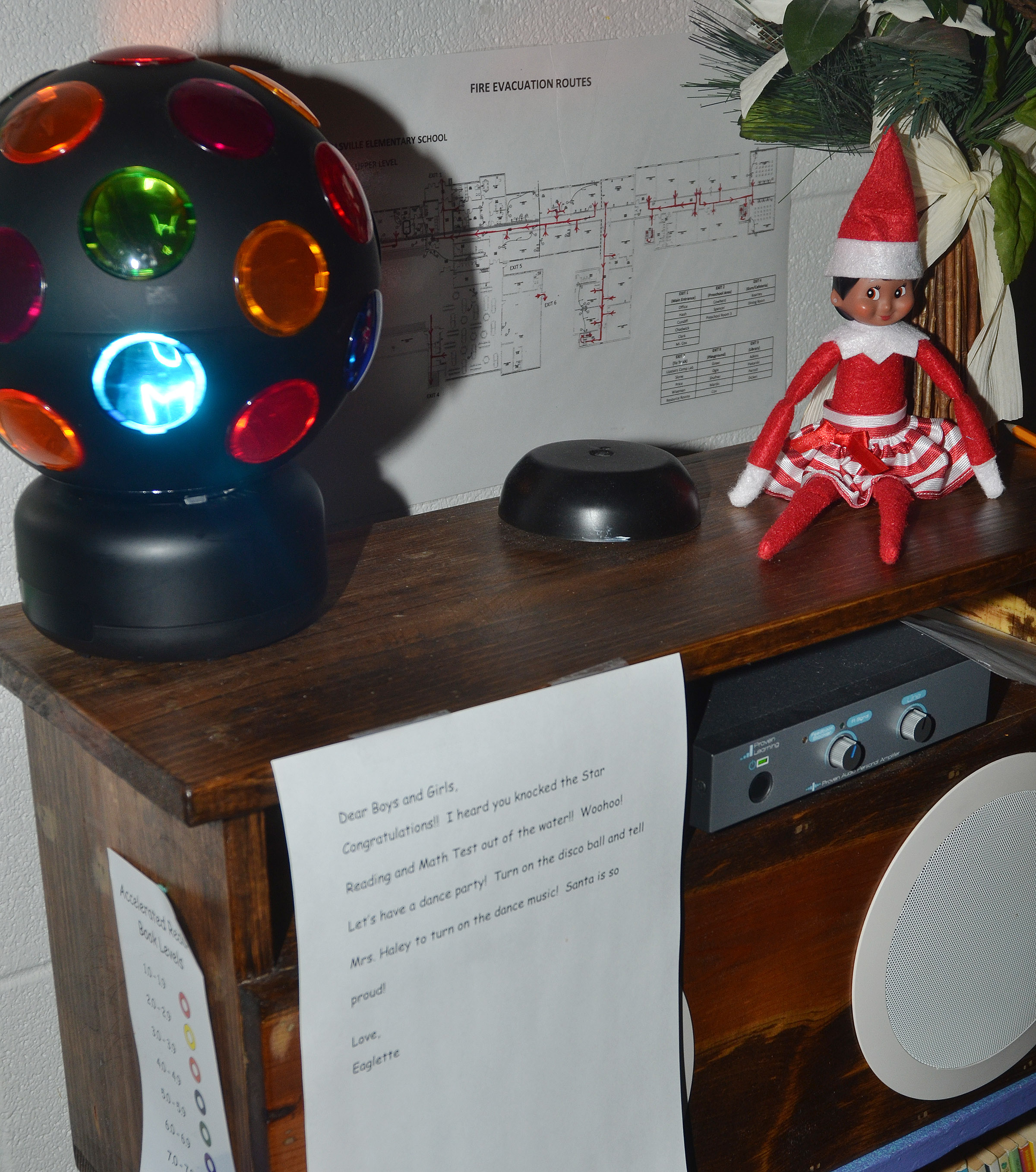 Eaglette, the elf visiting Patty Haley's third-grade classroom at CES, left a note for students telling them to have a disco party to celebrate their high test scores.