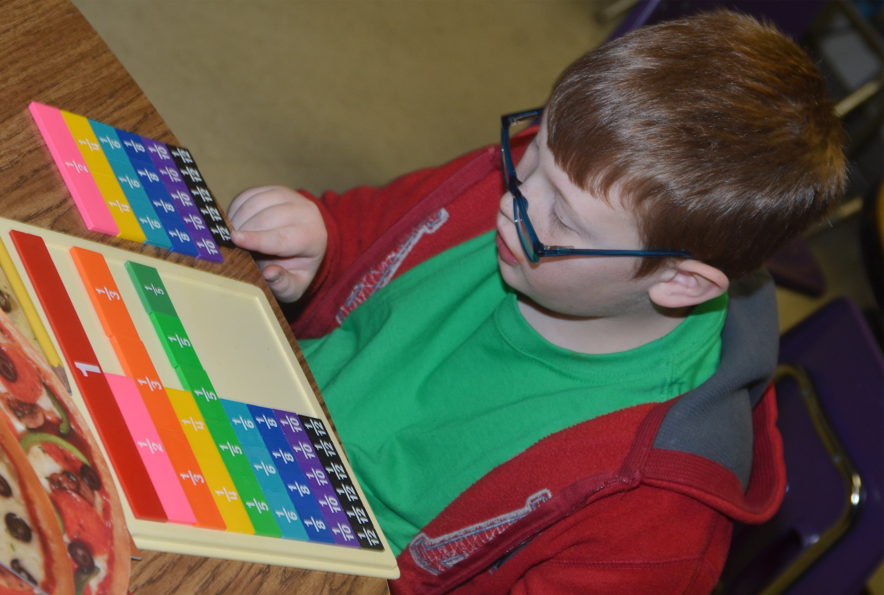 CES third-grader Aidan Phillips uses a math game to study fractions.