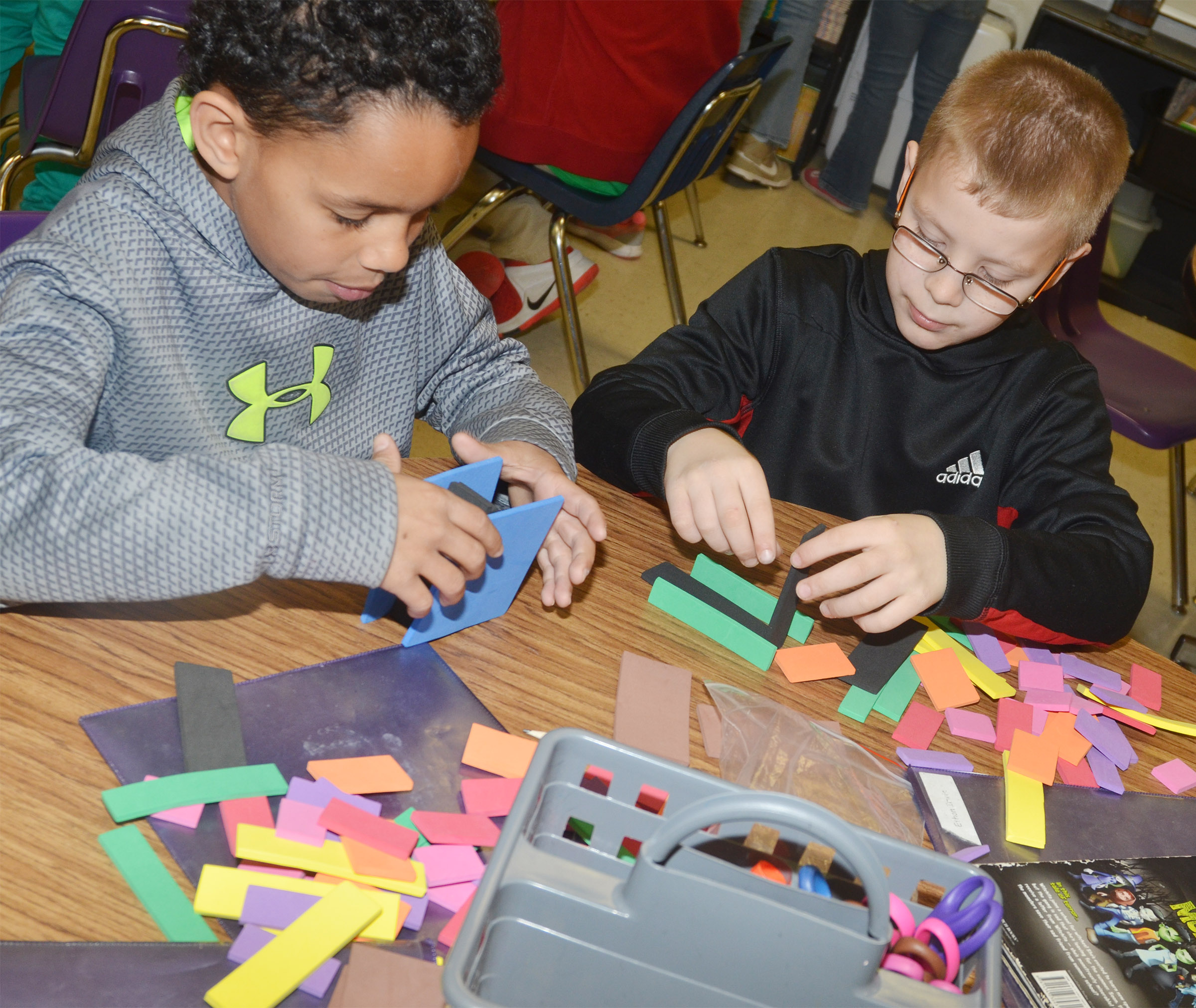 CES third-graders Anthony Goins, at left, and Ethan Irwin use blocks to study fractions.