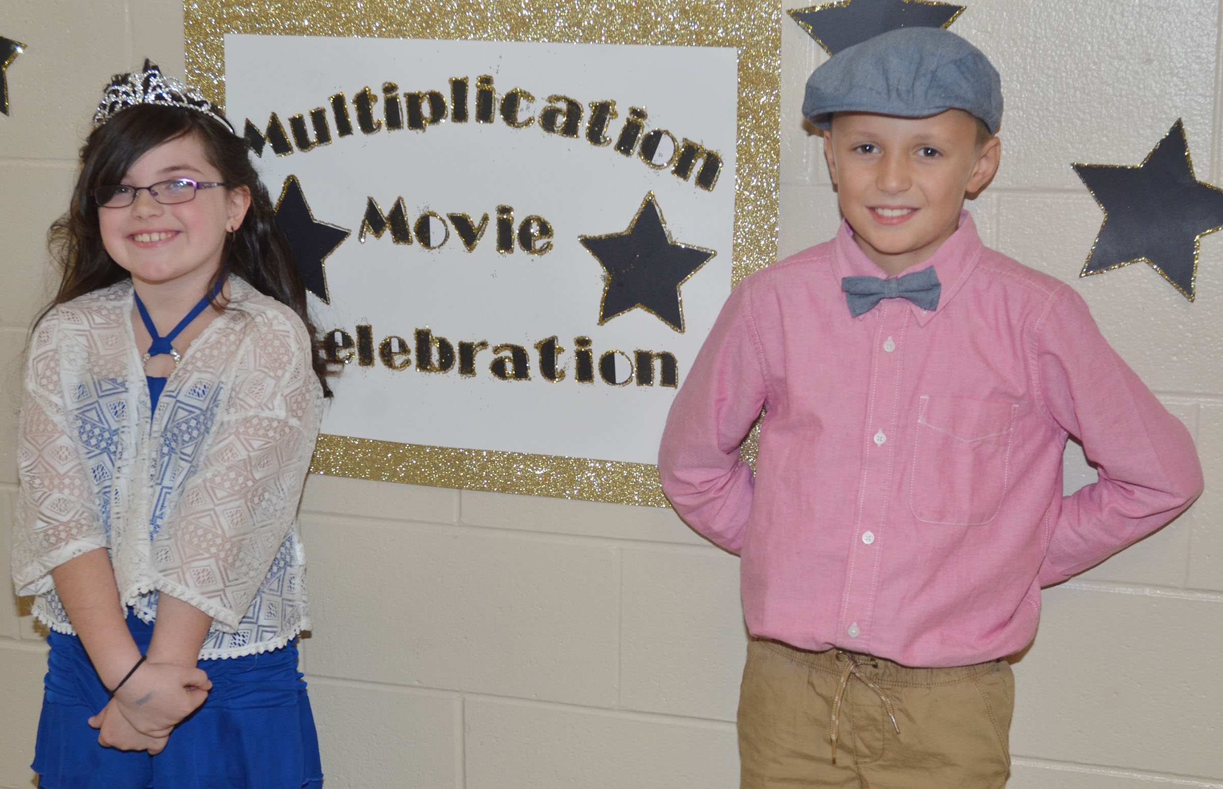 CES third-graders Lauren Pace, at left, and Cameron Taylor dress as their favorite idiom, dressing to the nines.