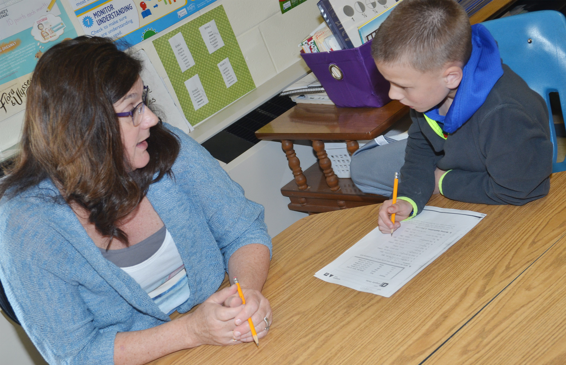 CES third-grade teacher Patty Haley works with Jayden Harris to teach him about irregular verbs.