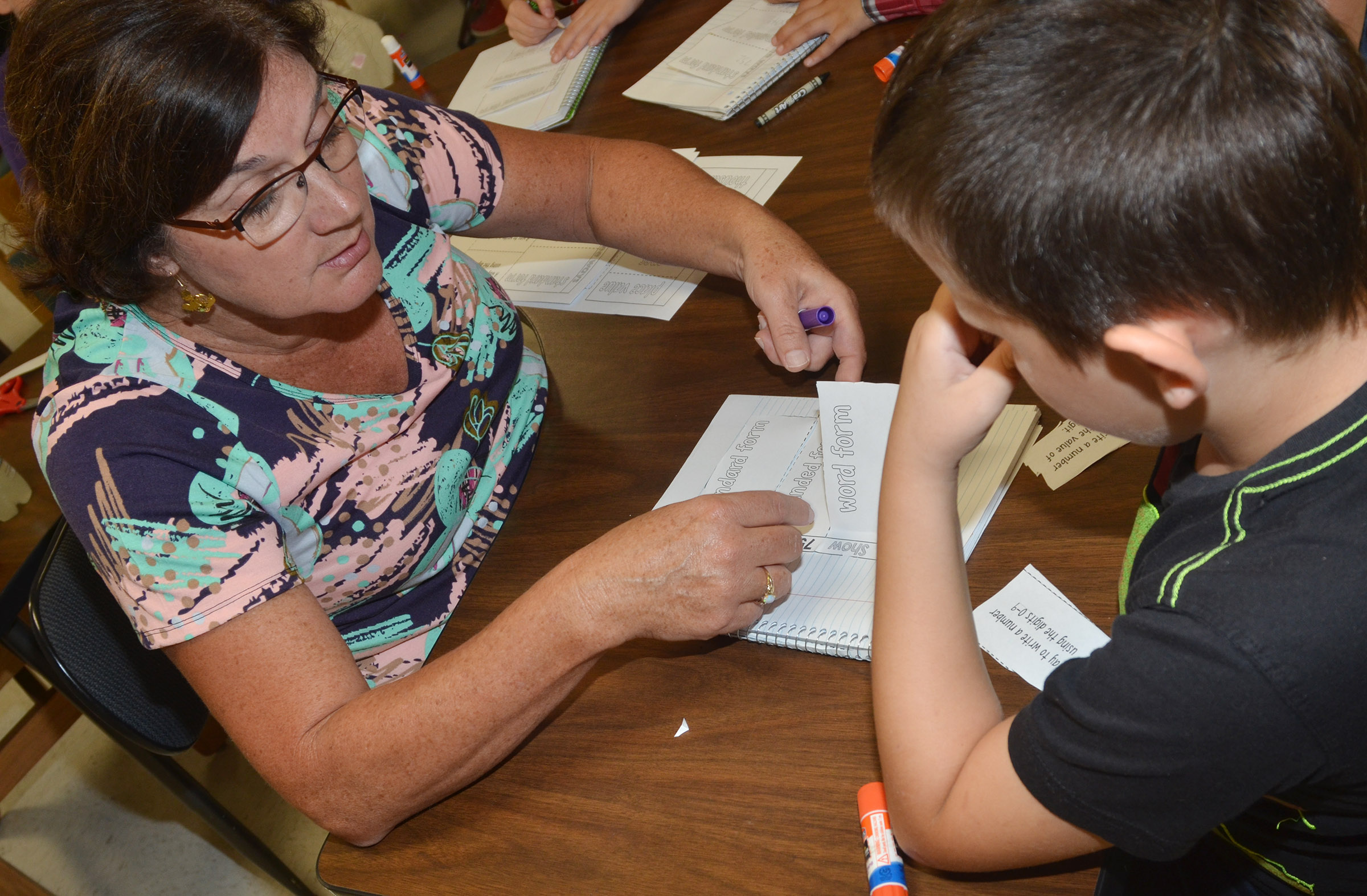 CES teacher Patty Haley helps third-grader Codey Parks understand word, expanded and standard forms.