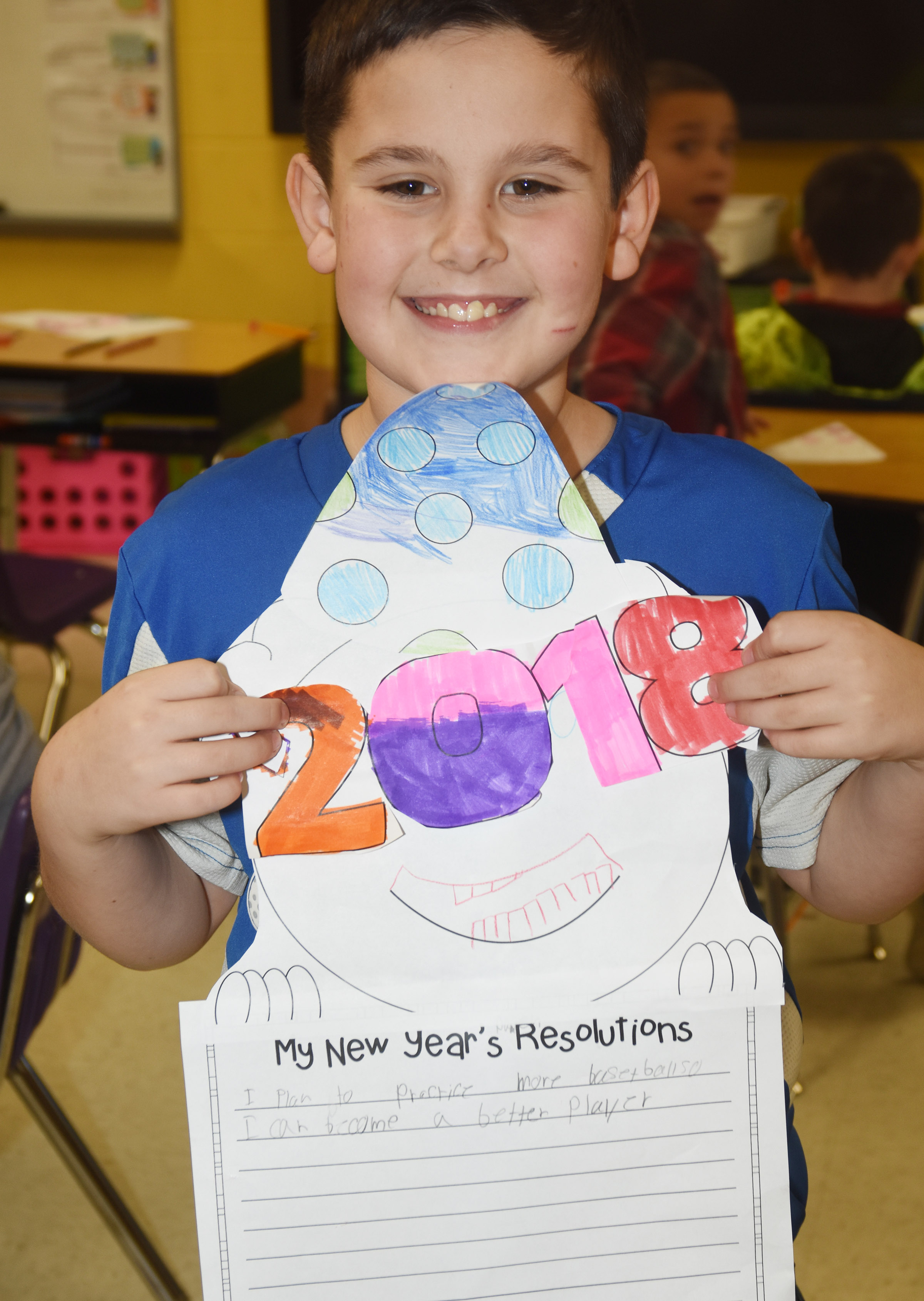 CES third-grader Damien Clark holds his New Year's resolution project.
