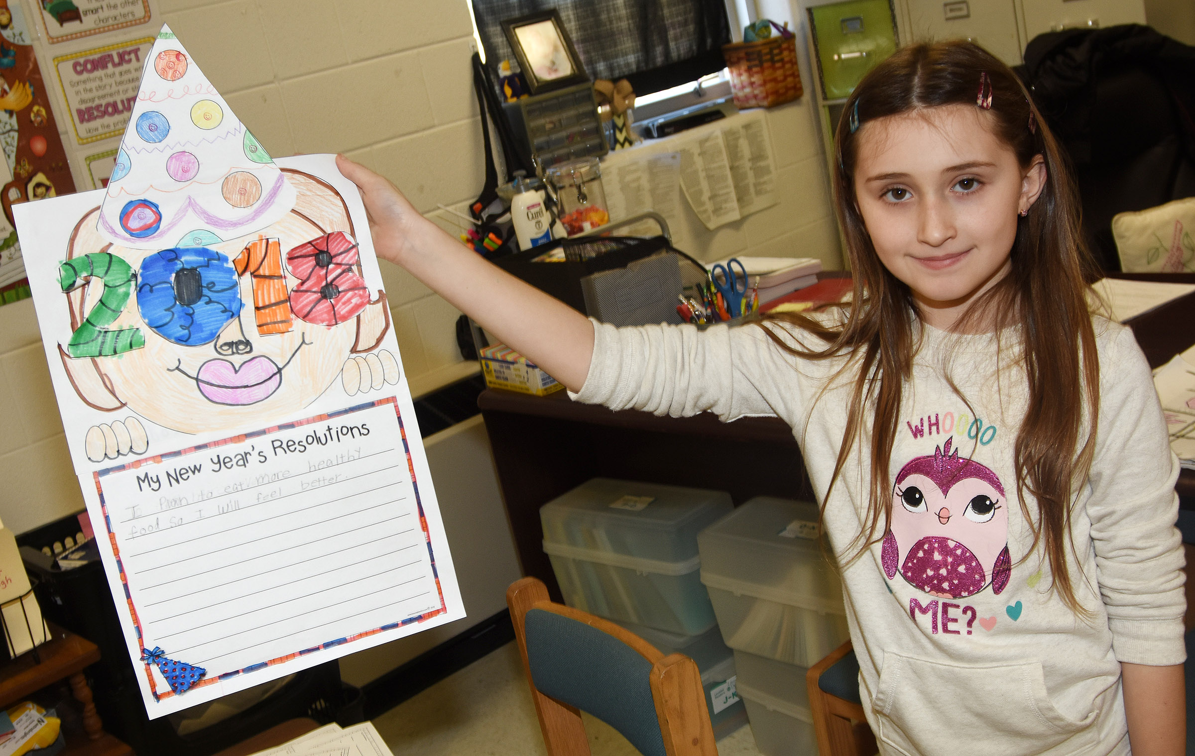 CES third-grader Cadence Burton holds her New Year's resolution project.