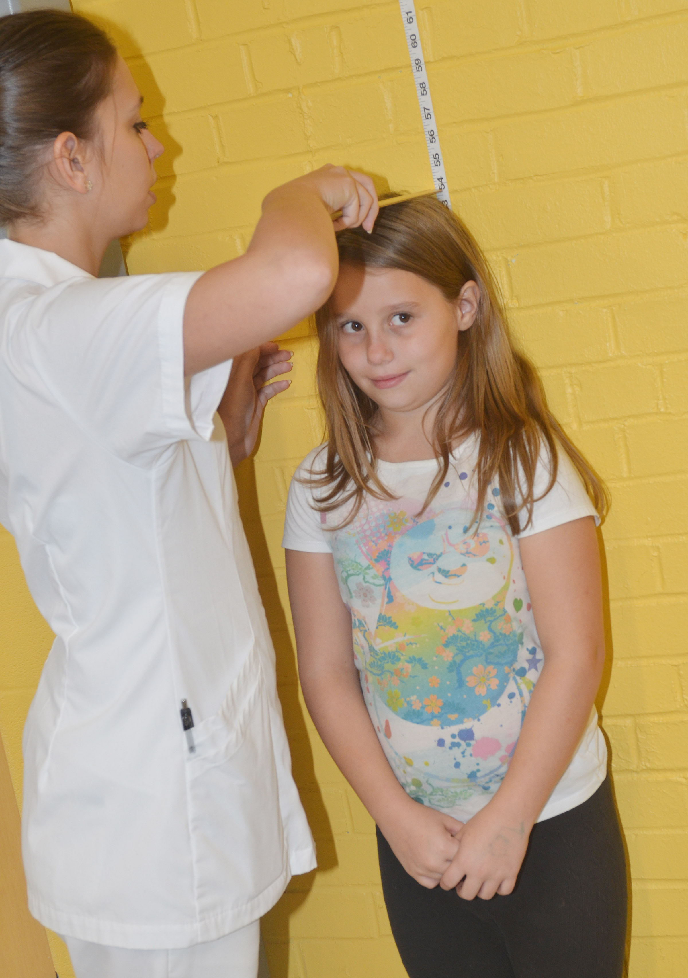 CES fourth-grader McKailynn Grubaugh has her height measured by Campbellsville University nursing student Deanna Chapman.