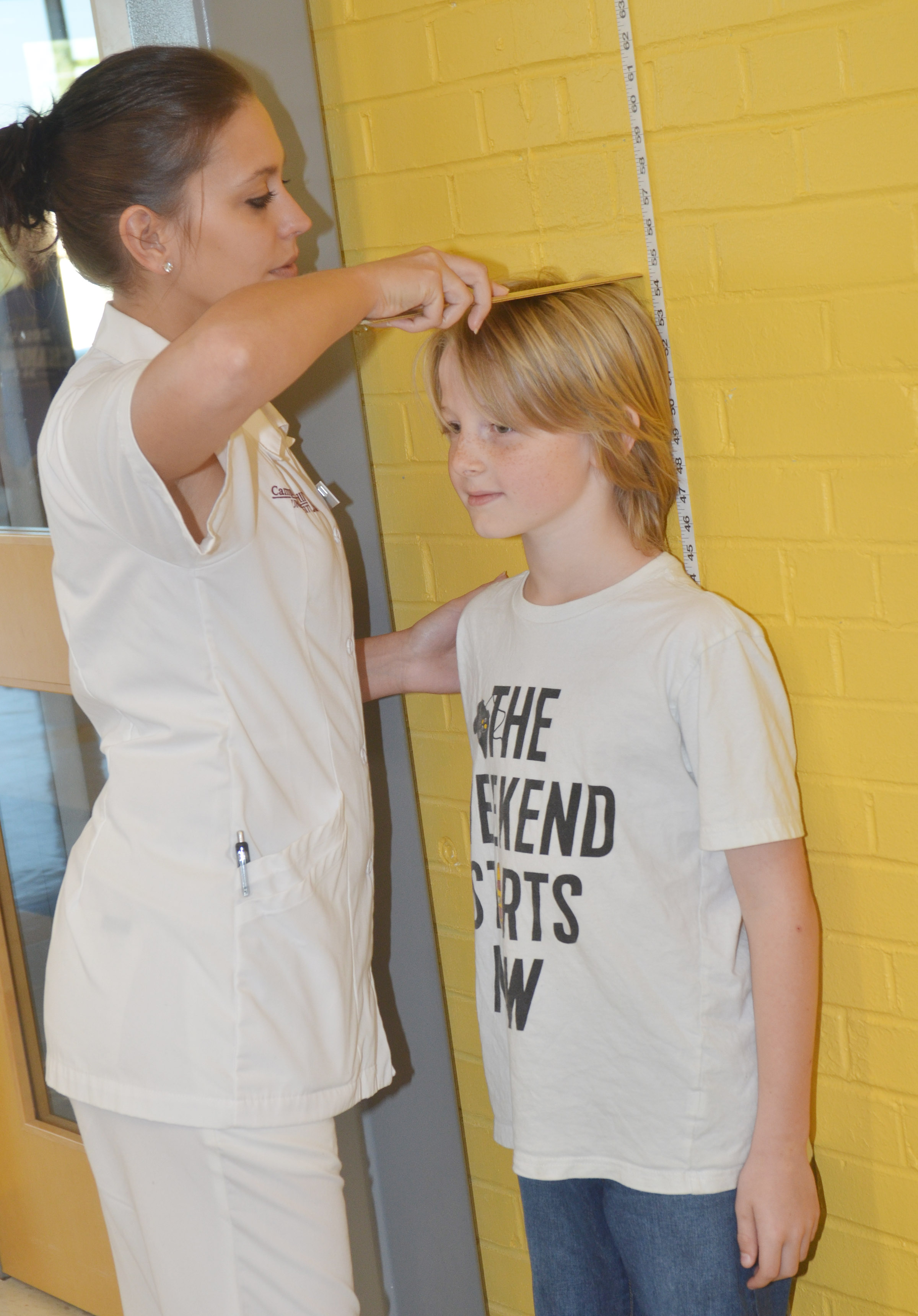 CES fourth-grader Devin Underwood has his height measured by Campbellsville University nursing student Deanna Chapman.