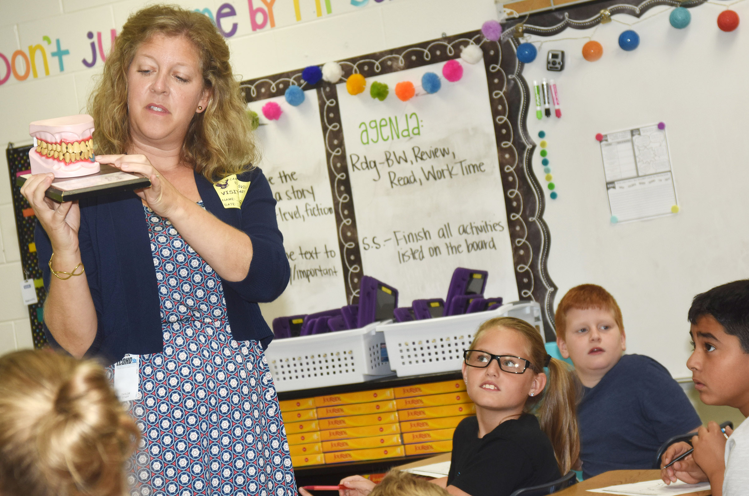 Jackie Hodges, health educator at Taylor County Health Department, shows CES fourth-graders the damage tobacco use can cause to a person's teeth.