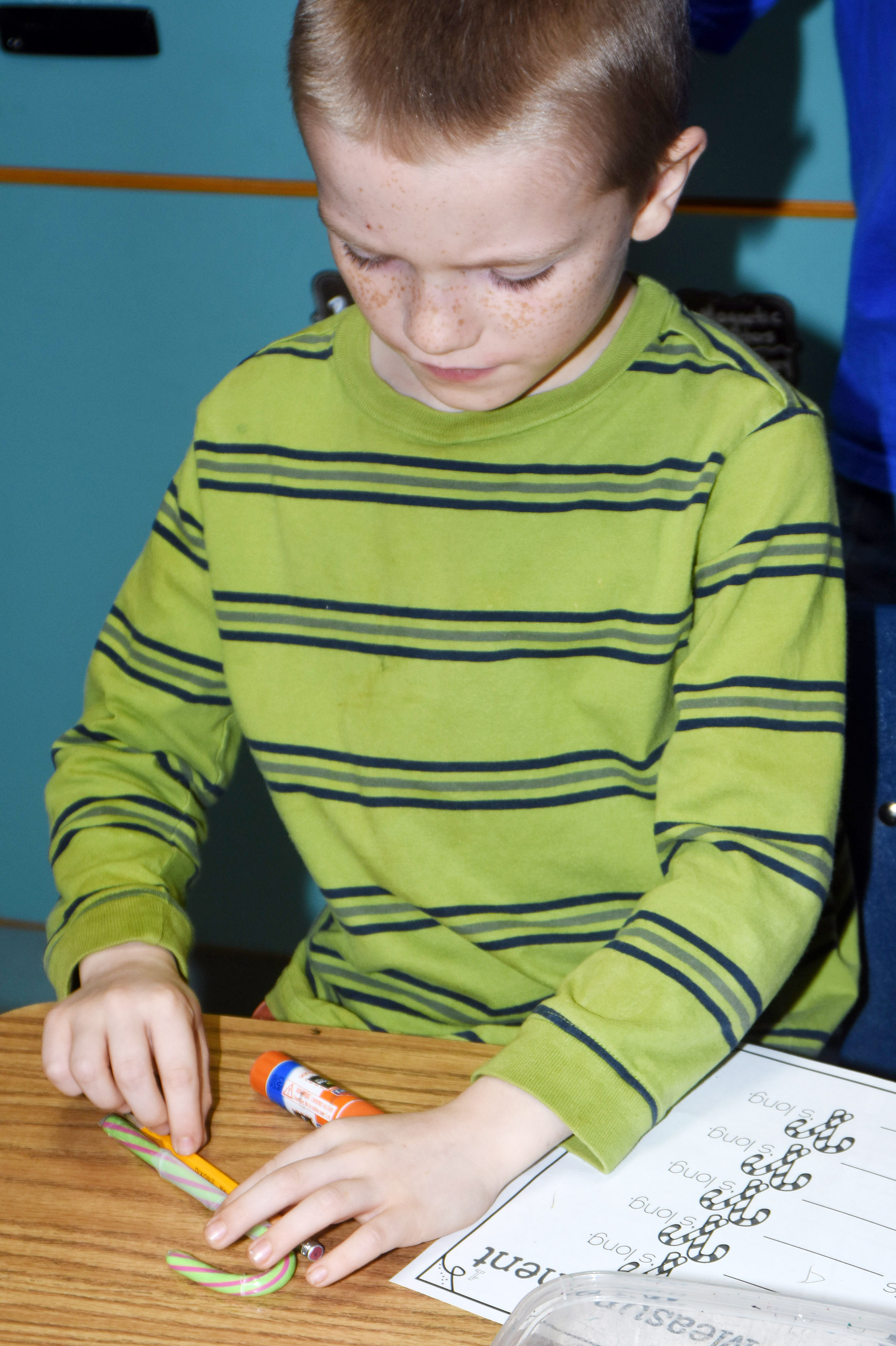 CES second-grader Jason Eggers measures a pencil with his candy cane.