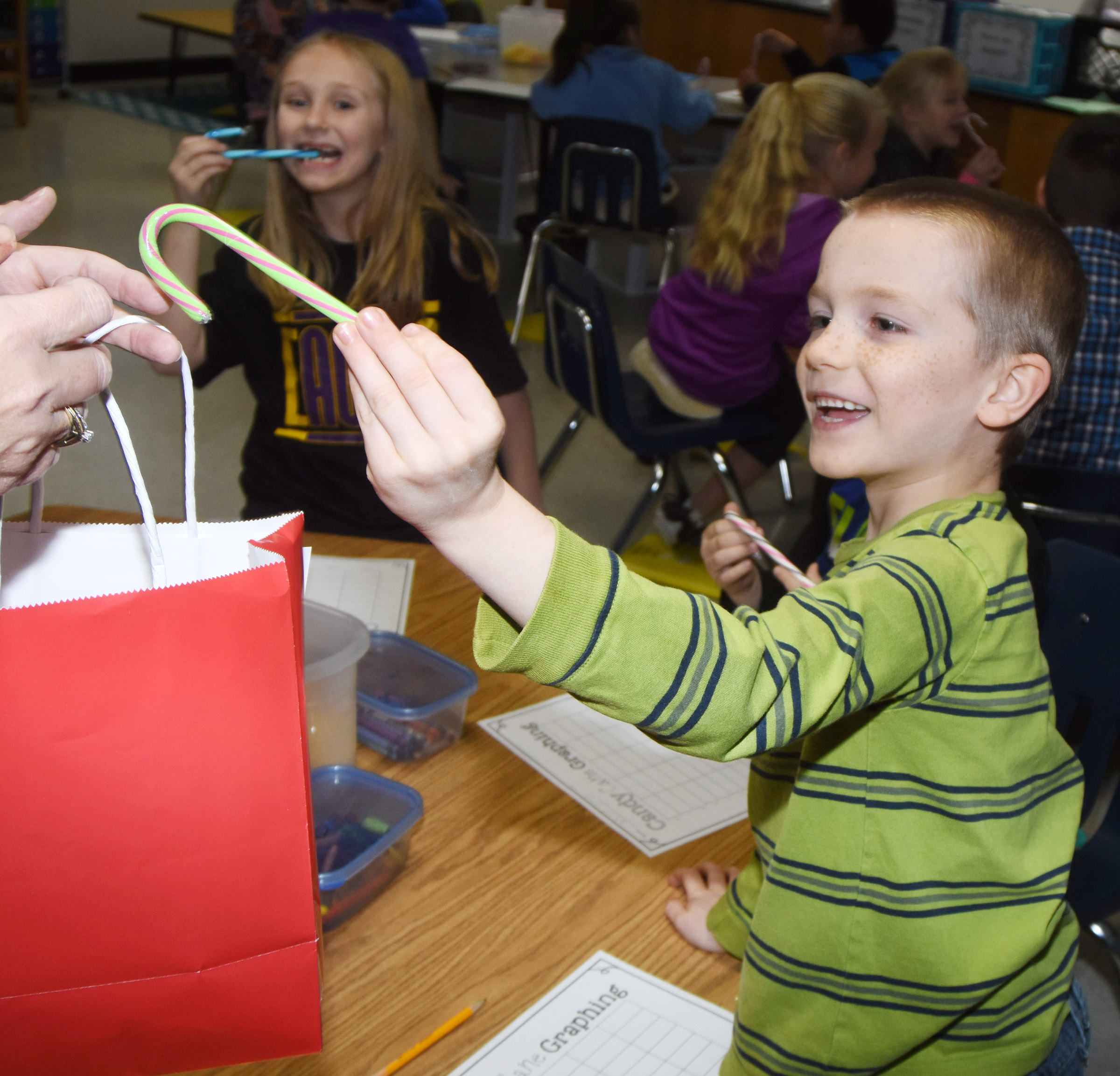 CES second-grader Jason Eggers is excited to get his candy cane.