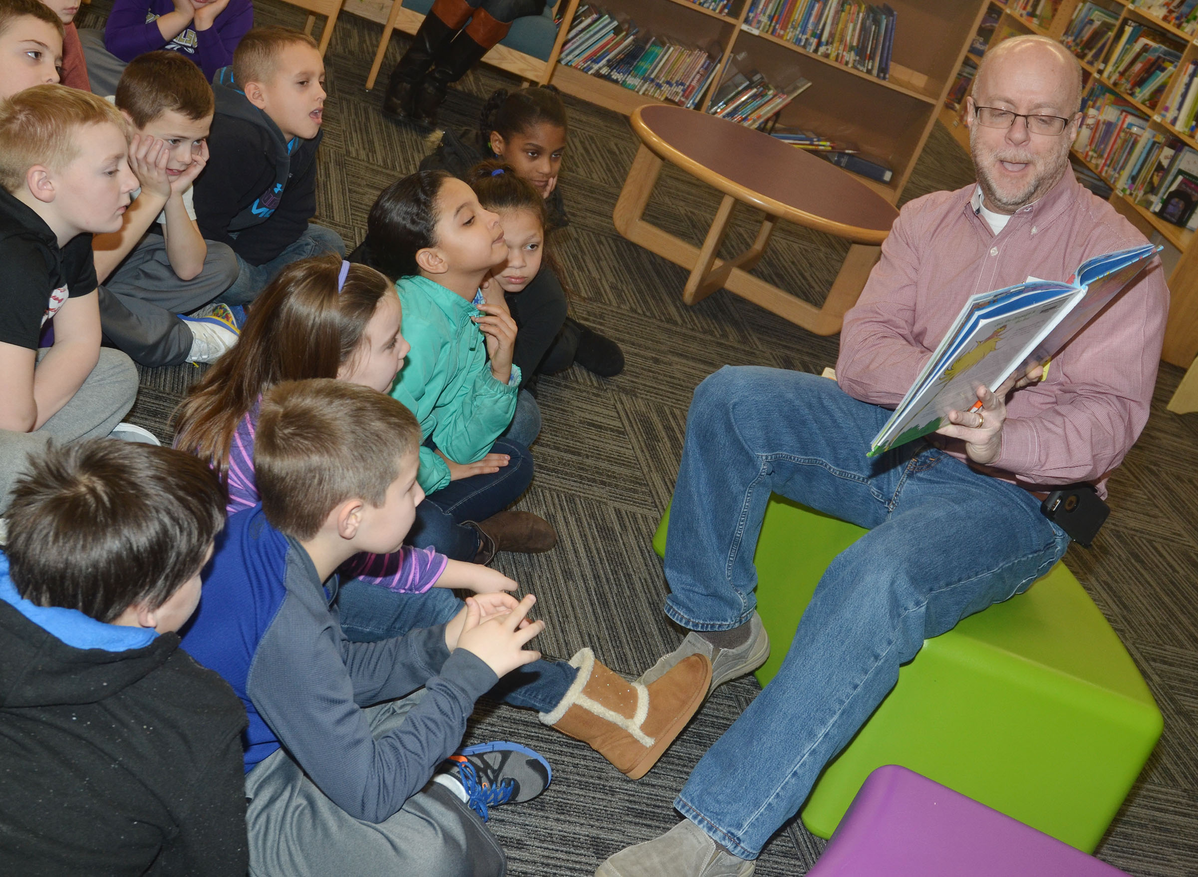 "Eric Bruns reads to CES students on ""I Love to Read"" Day."