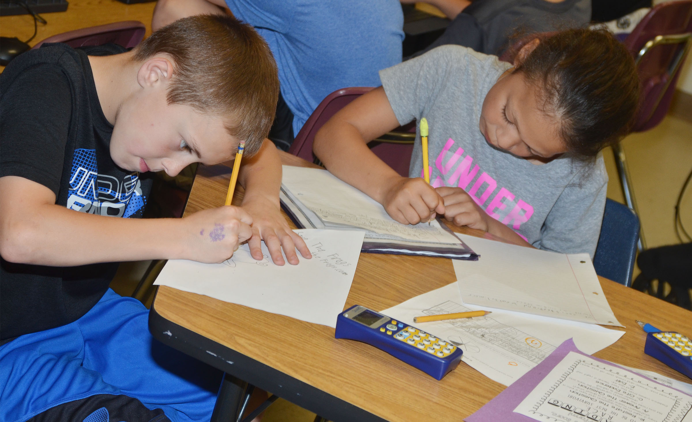 CES third-graders Keaton Hord, at left, and Breona Bridgewater work a math problem.