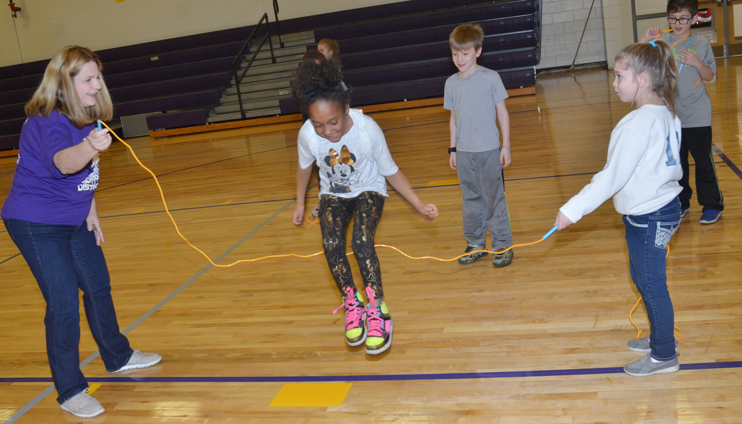 CES Guidance Counselor Sonya Orberson, at left, and third-grader Chyanne Christie jump rope with second-grader Lashonda Wilkinson.