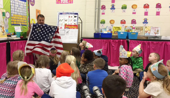 Dan Durham, program director at Air Evac Lifeteam and pastor at Stewarts Creek Baptist Church, speaks to CES kindergarteners about the American flag.