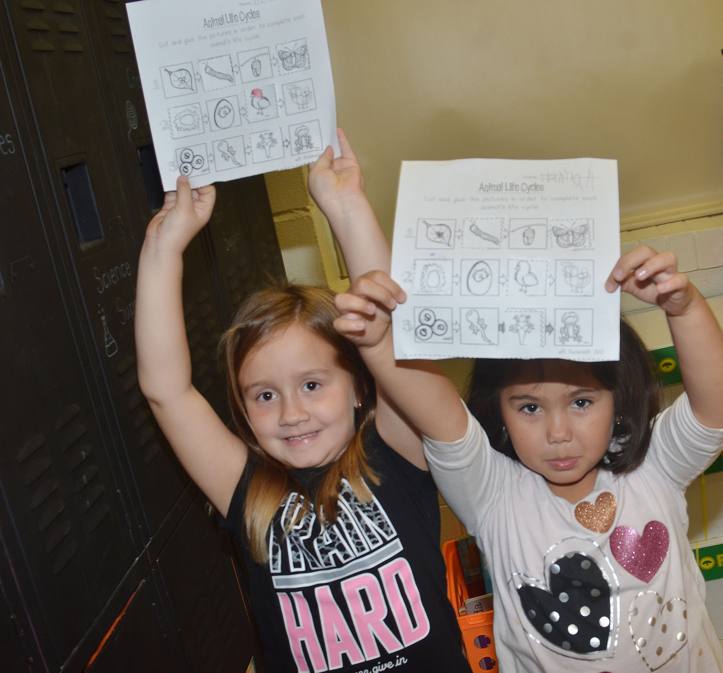 CES kindergartener Natalee Shaw, at left, and Hannah Matias show their completed worksheets.