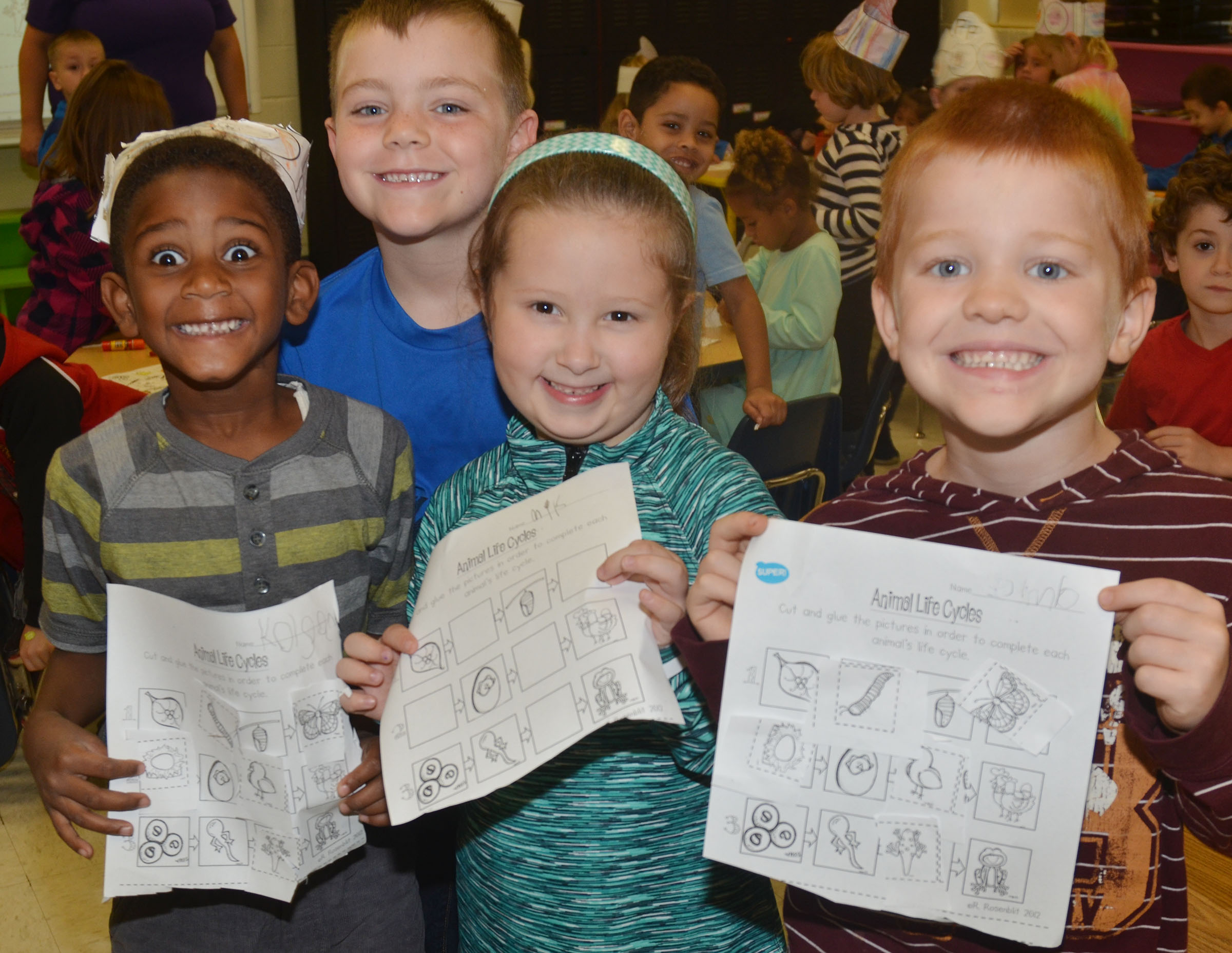 From left, CES kindergarteners Kasen Smith, Landon Jones, Mikaylah Flynn and Cambrien Couch hold their completed worksheets.