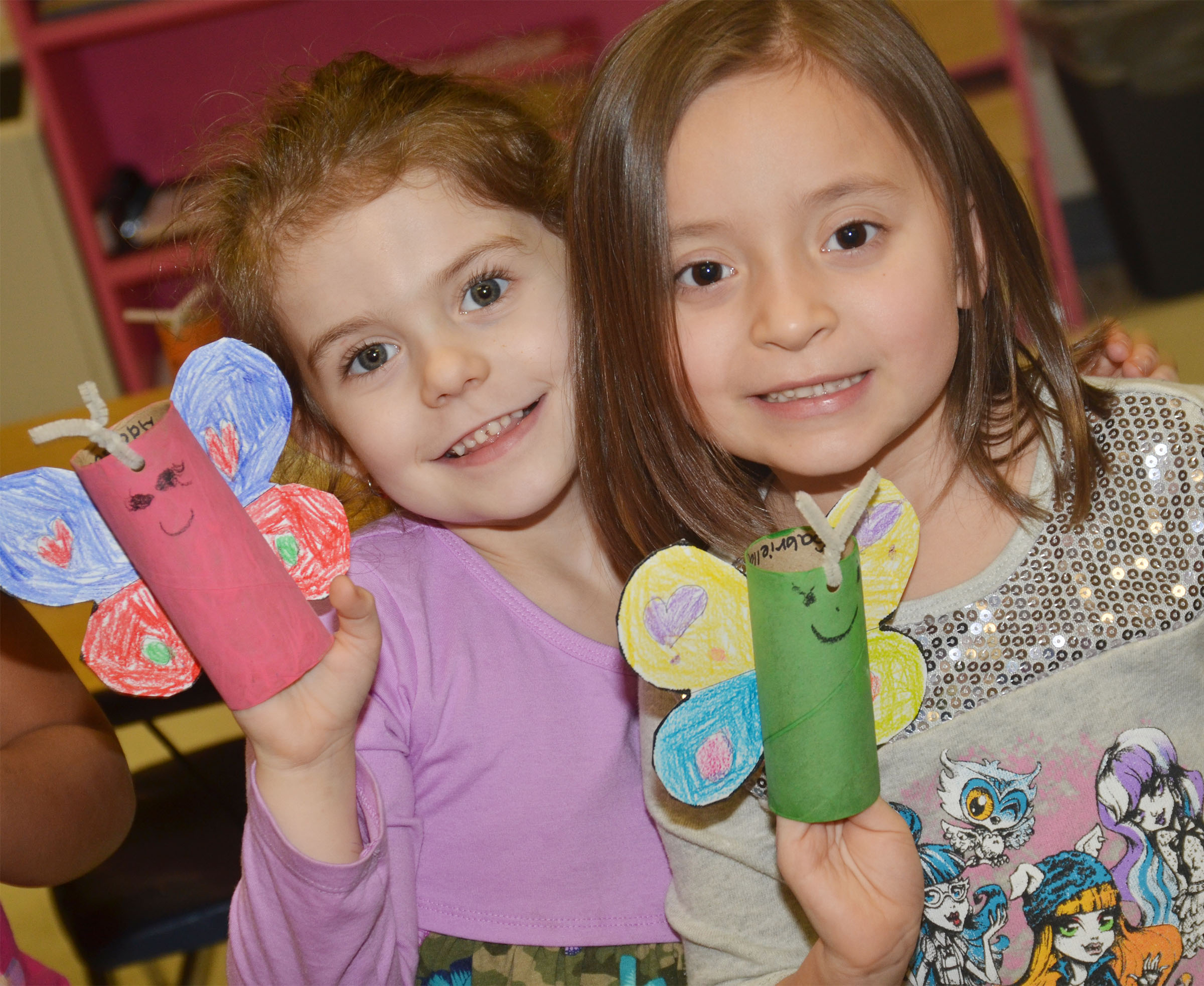 CES kindergarteners Addison Beckley, at left, and Gabriella Tate hold their butterflies.