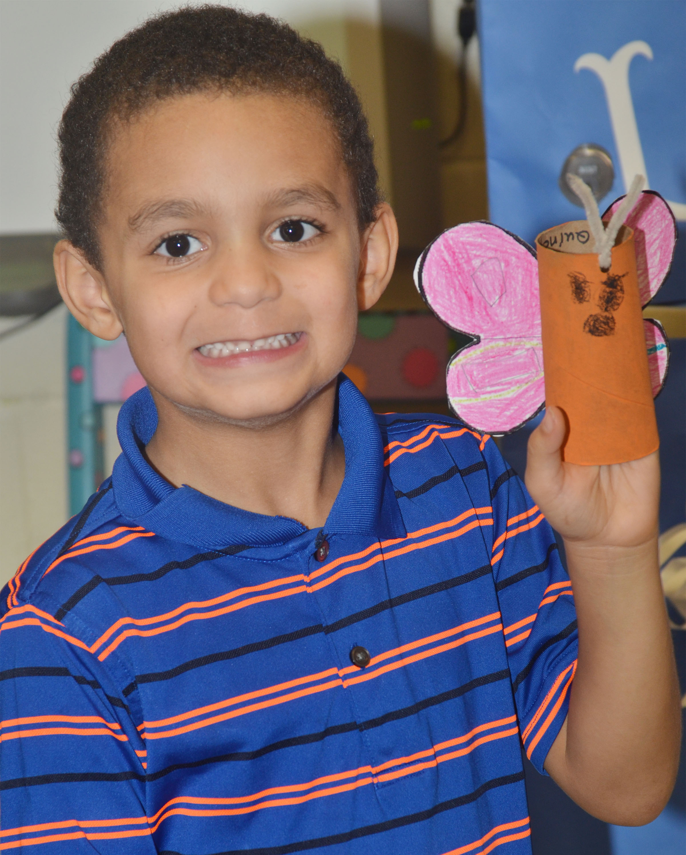 CES kindergartener Quincy Travis holds his butterfly.