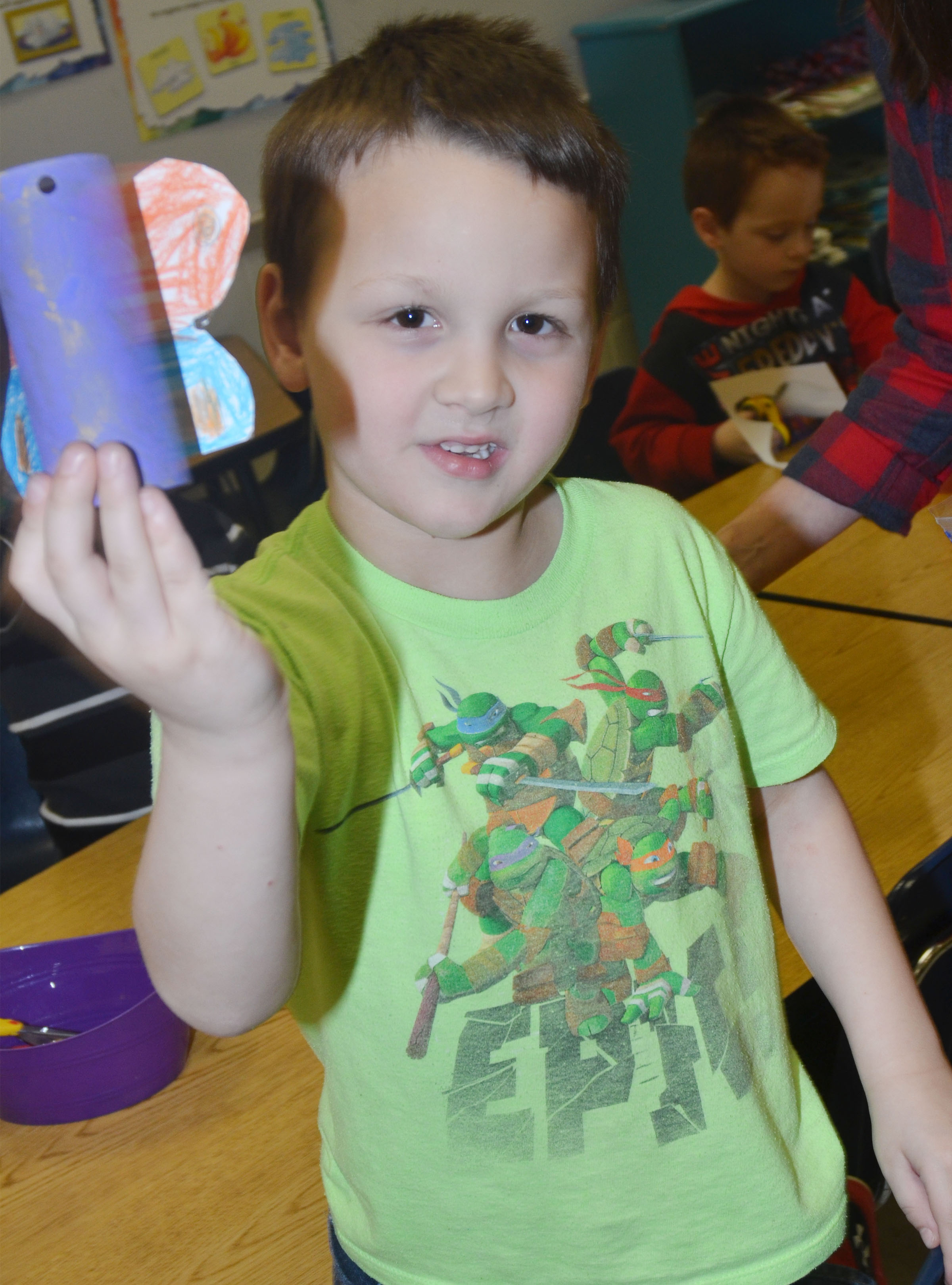 CES kindergartener Justice Nelson holds his butterfly.