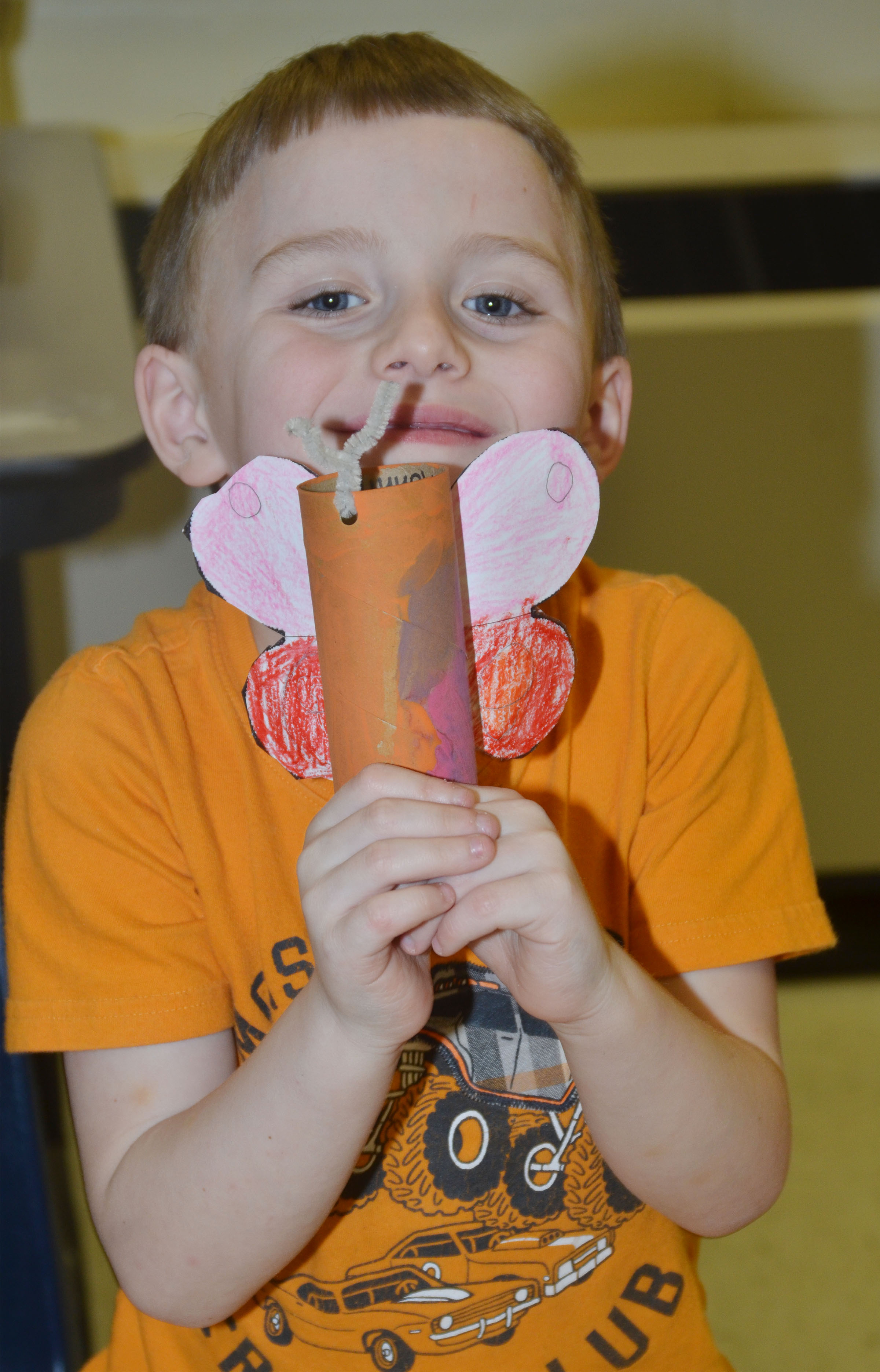 CES kindergartener Ronnie Allen holds his butterfly.