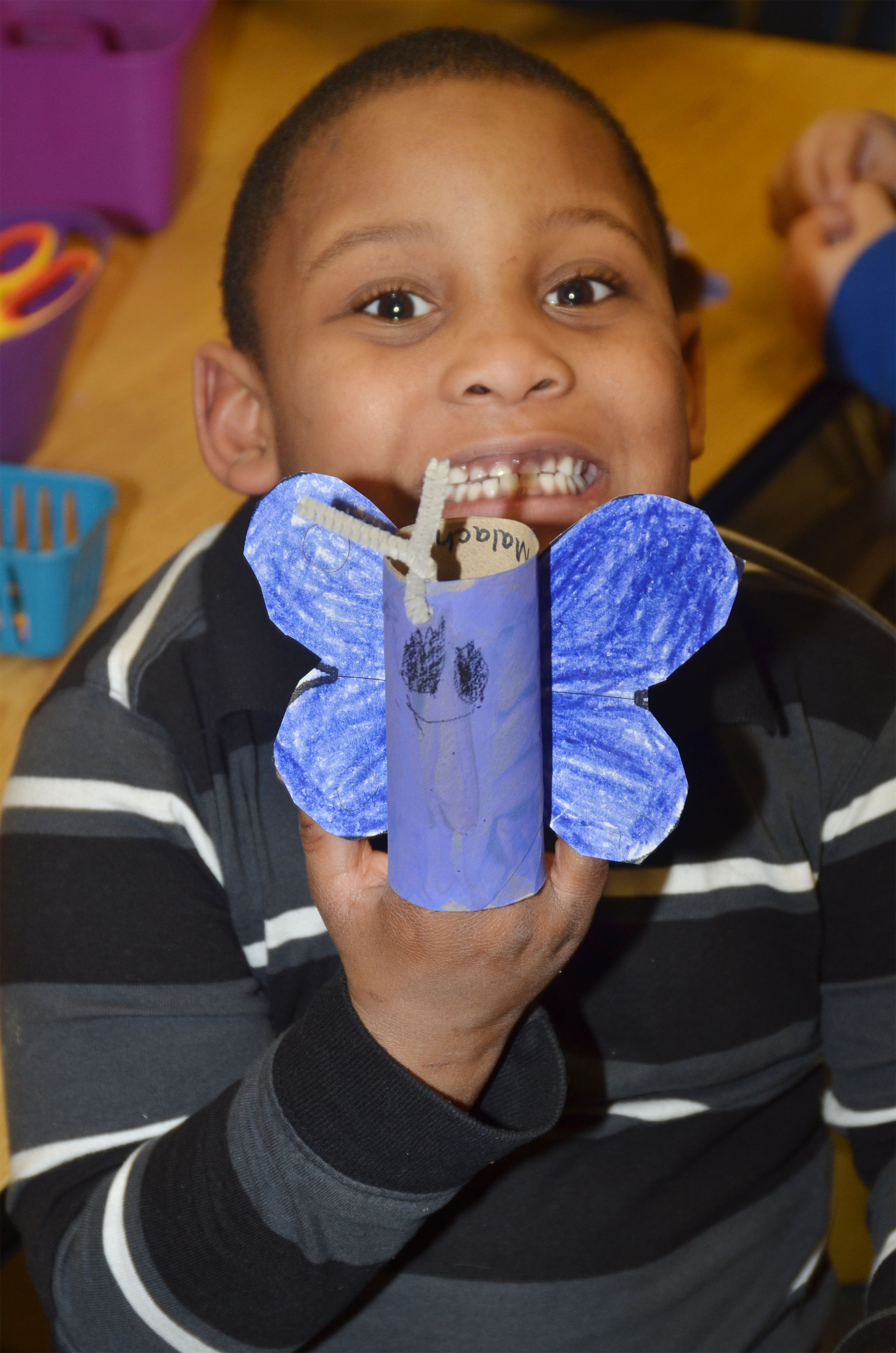 CES kindergartener Malachi Conner holds his butterfly.