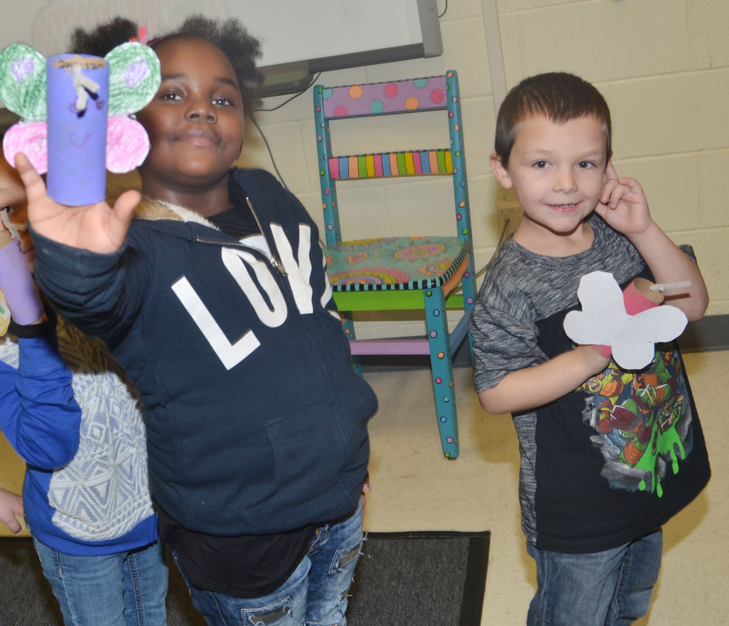 CES kindergarteners Destinee Henry-Turner, at left, and Brayden Perkins hold their butterflies.