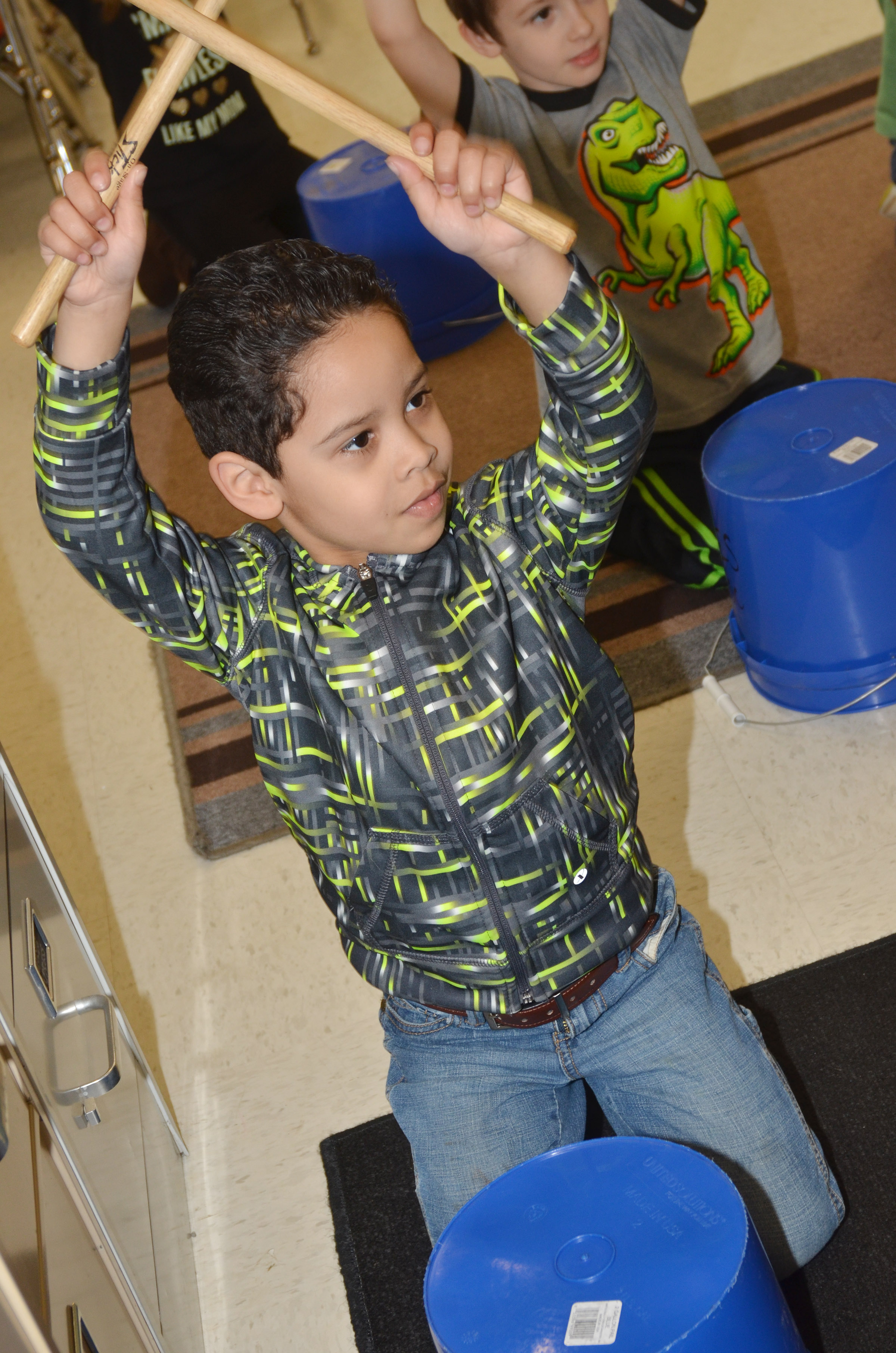CES kindergartener Demarcus Noyola plays the drums.