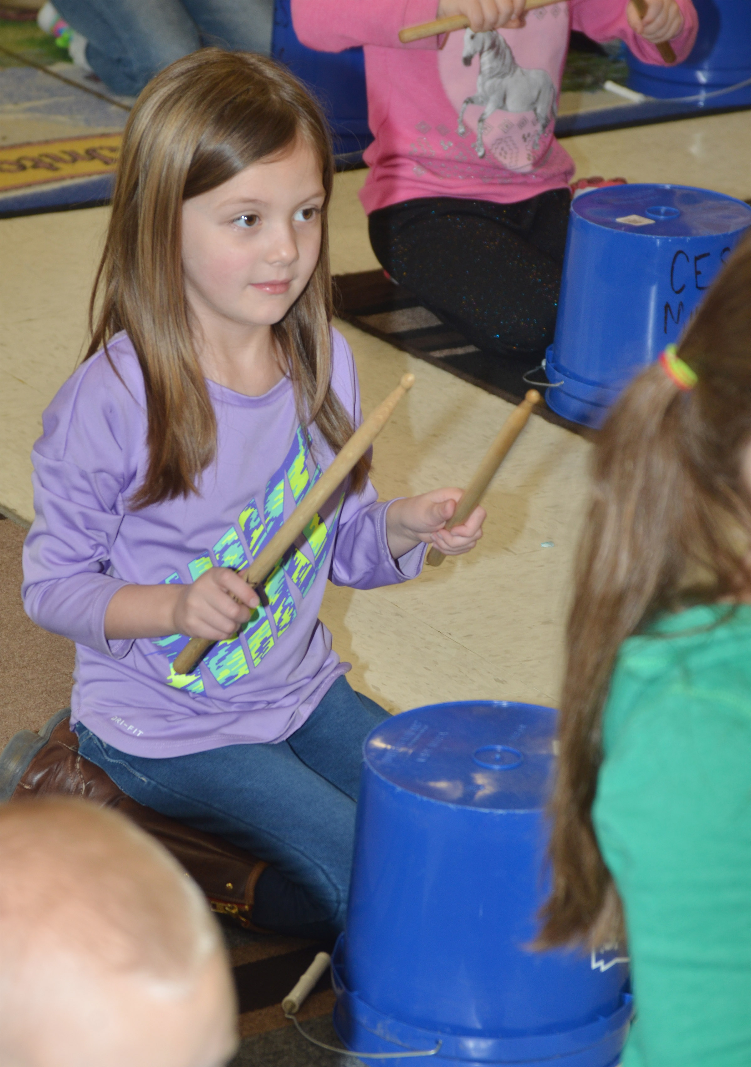 CES kindergartener Delaney Staton plays.