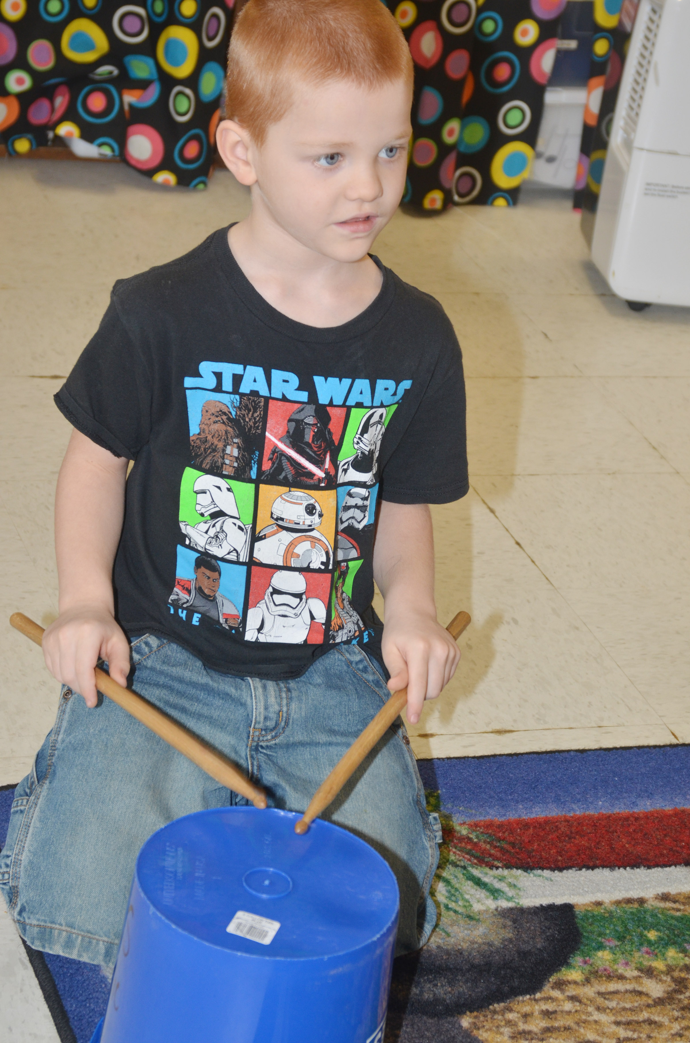 CES kindergartener Cambrien Couch plays the drums.