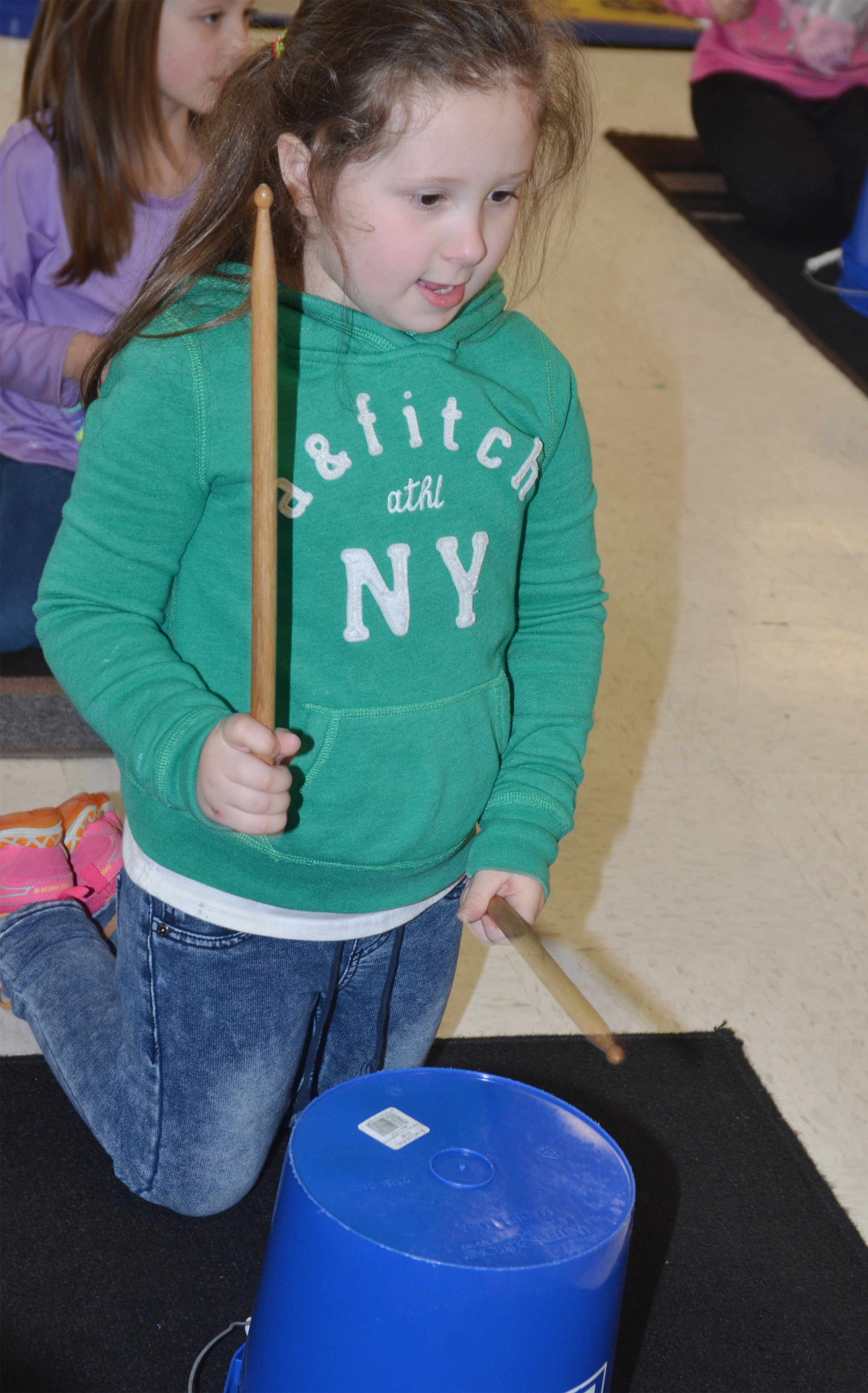 CES kindergartener Mikaylah Flynn plays the drums.