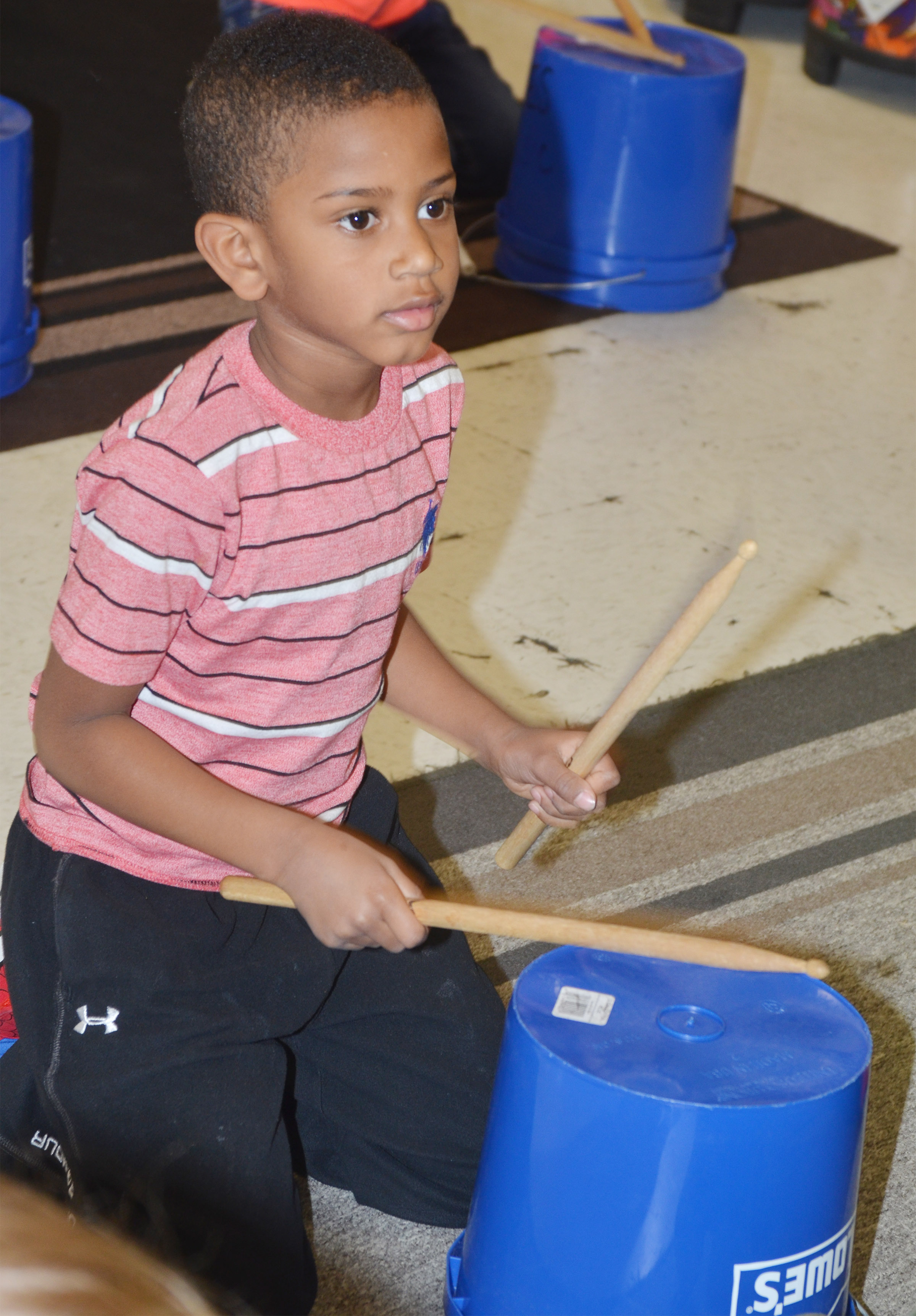 CES kindergartener Kasen Smith plays the drums.