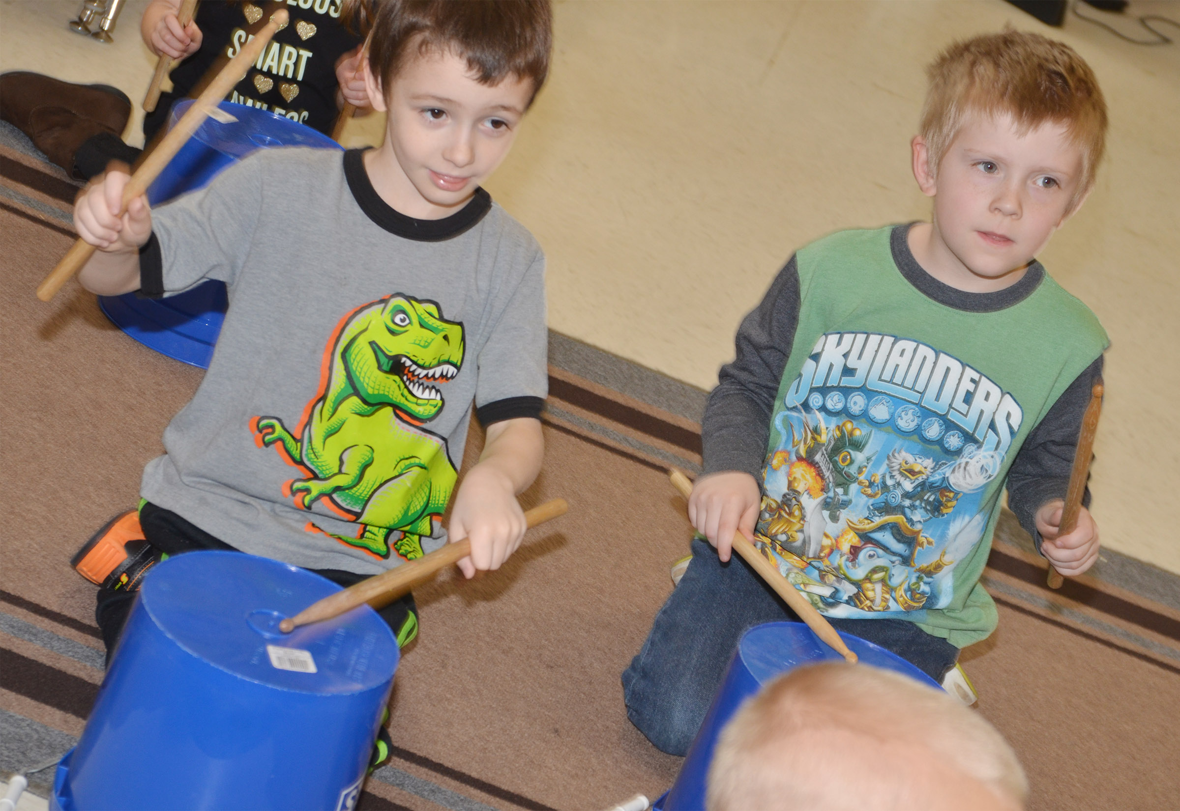 CES kindergarteners Bobby Bright, at left, and Gage Henderson play the drums.