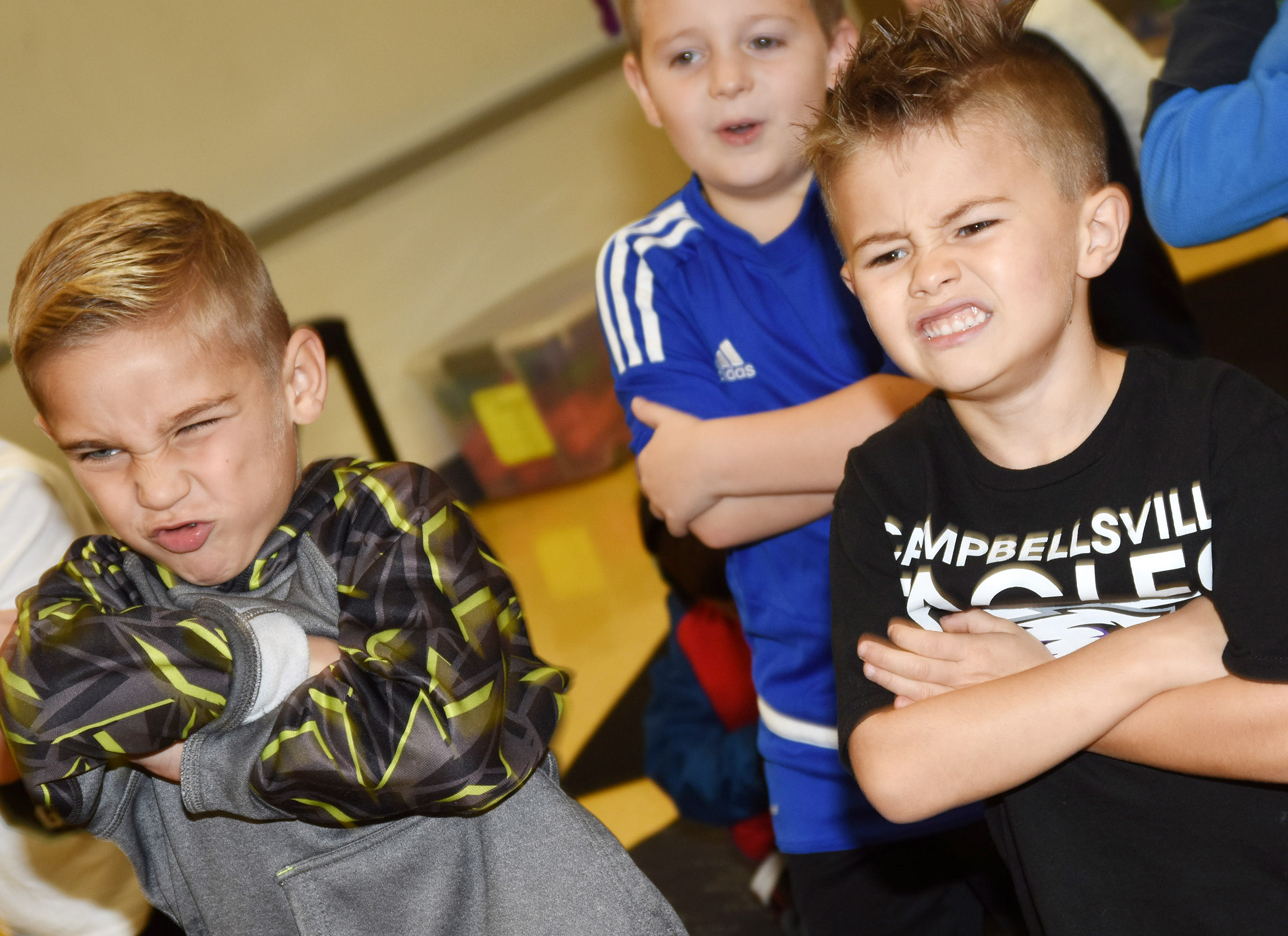 CES kindergarteners, from left, Dane Gray, Beckett Hill and Tate Jones put on their mad faces as they sing and dance.