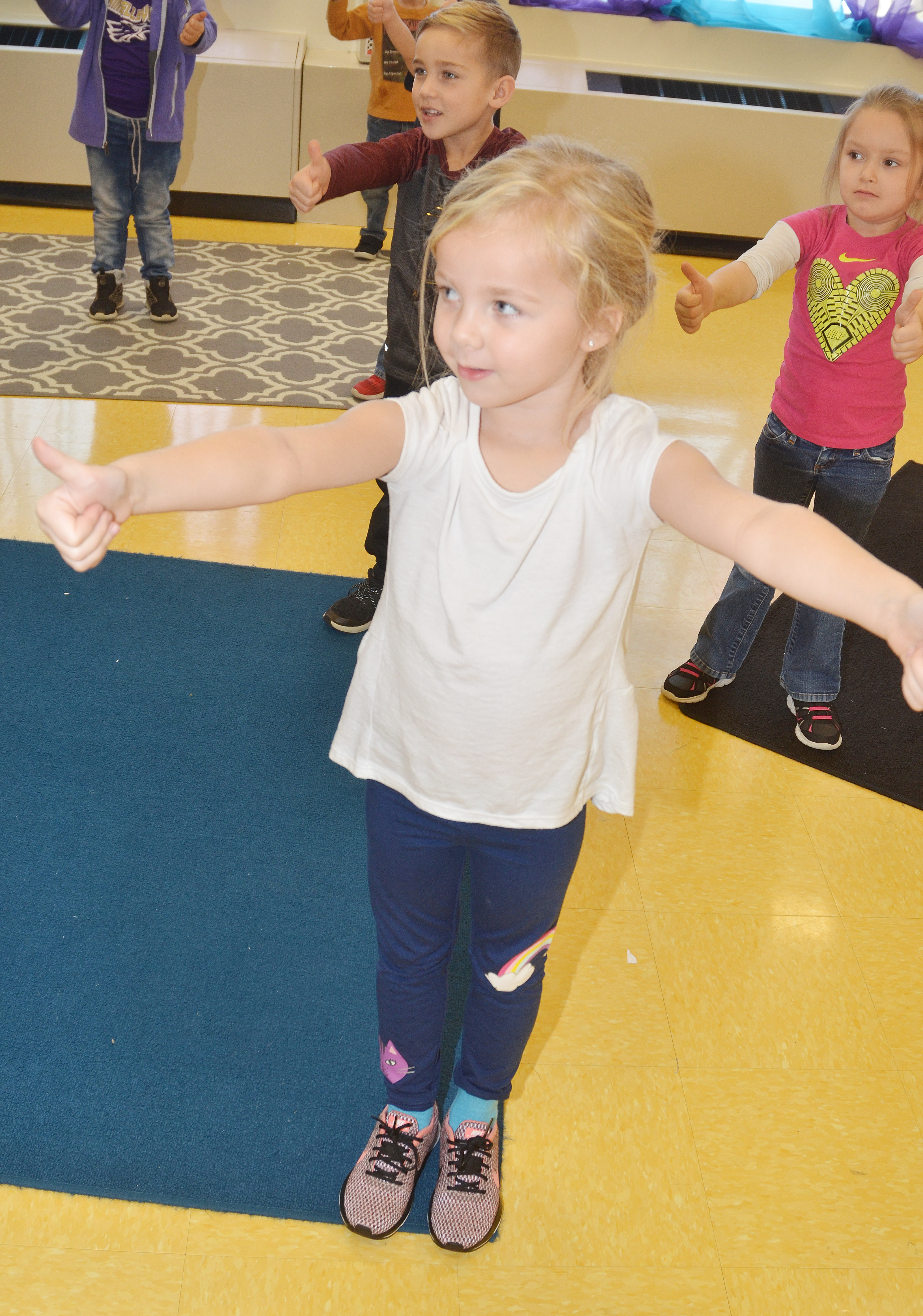 CES kindergartener Trinidy Gribbins dances with her classmates to a Christmas song.