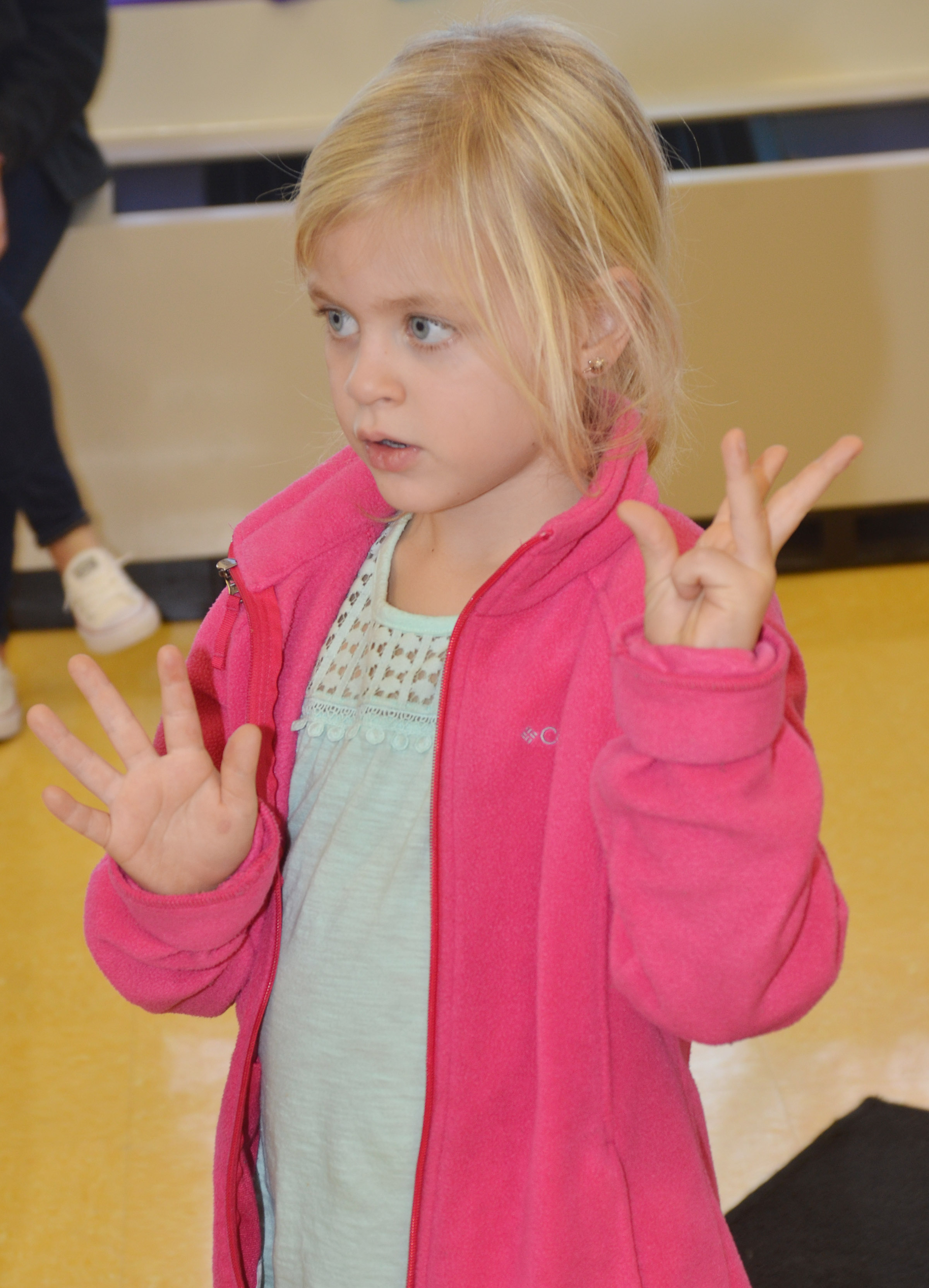 CES kindergartener Remi Petett counts as she sings a Christmas song.