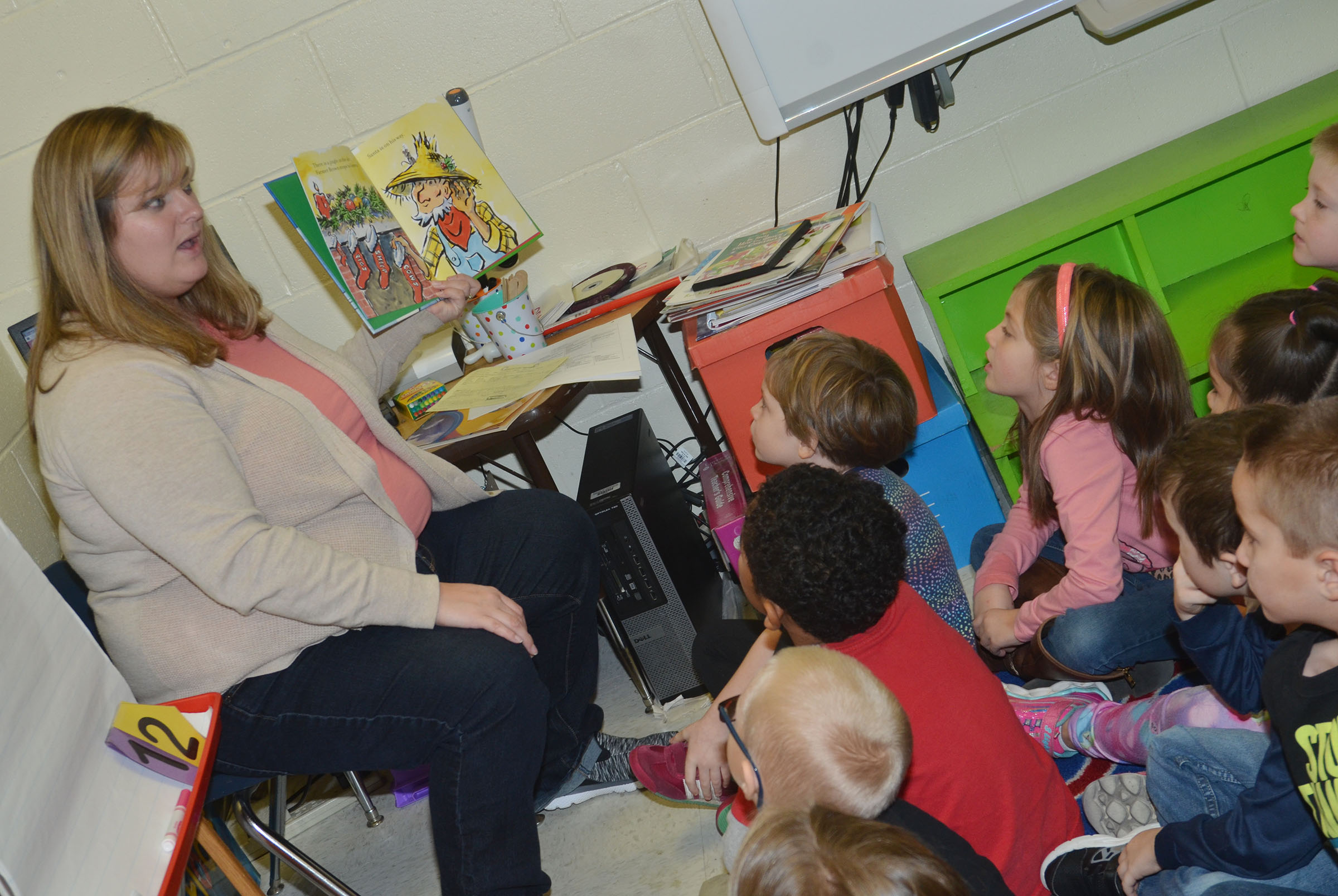 "CES kindergarten teacher Kimberly Clark reads ""Click, Clack, Ho! Ho! Ho!"" by Doreen Cronin to her students."