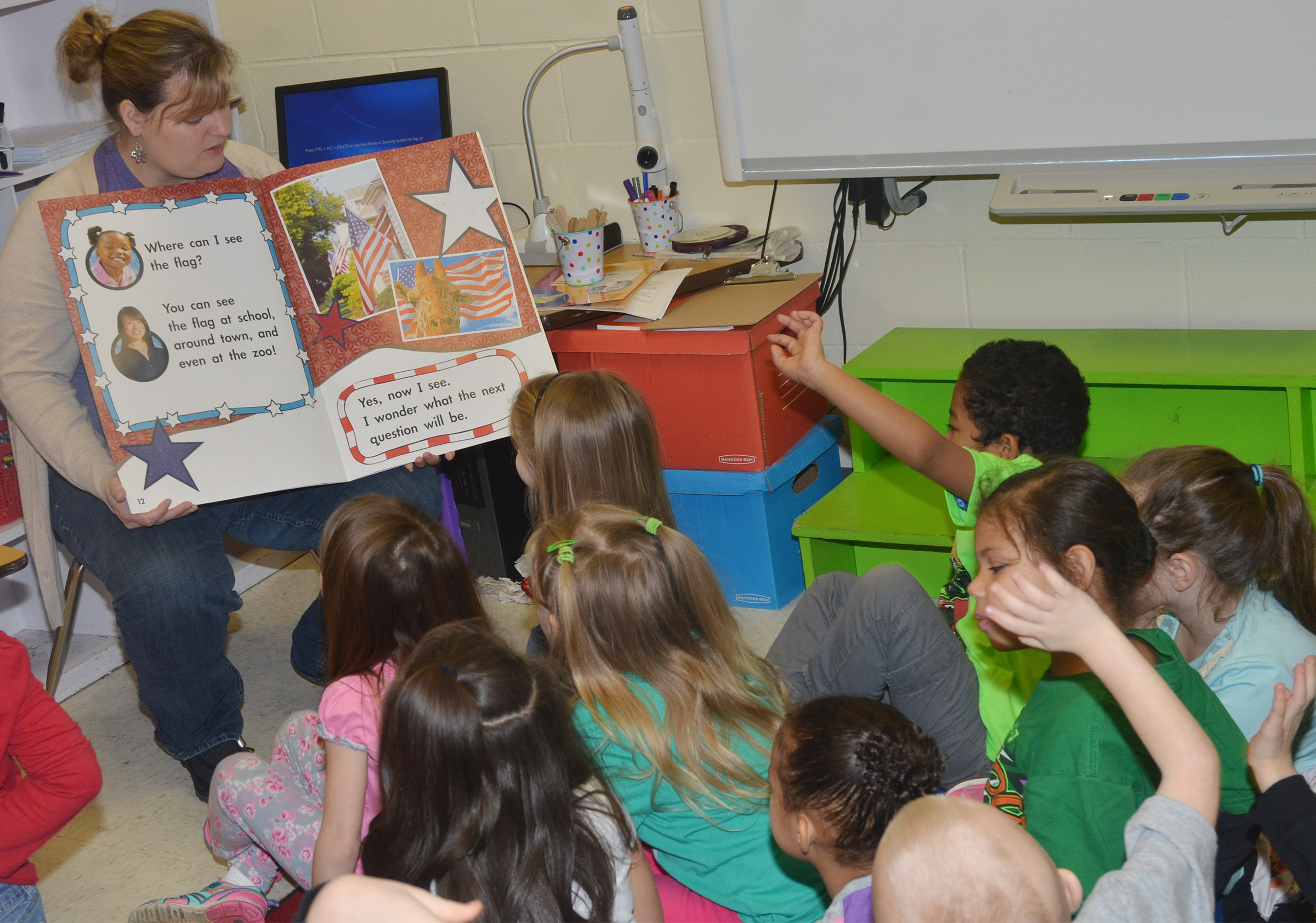 CES kindergarten teacher Kimberly Clark discusses the American flag with her students.