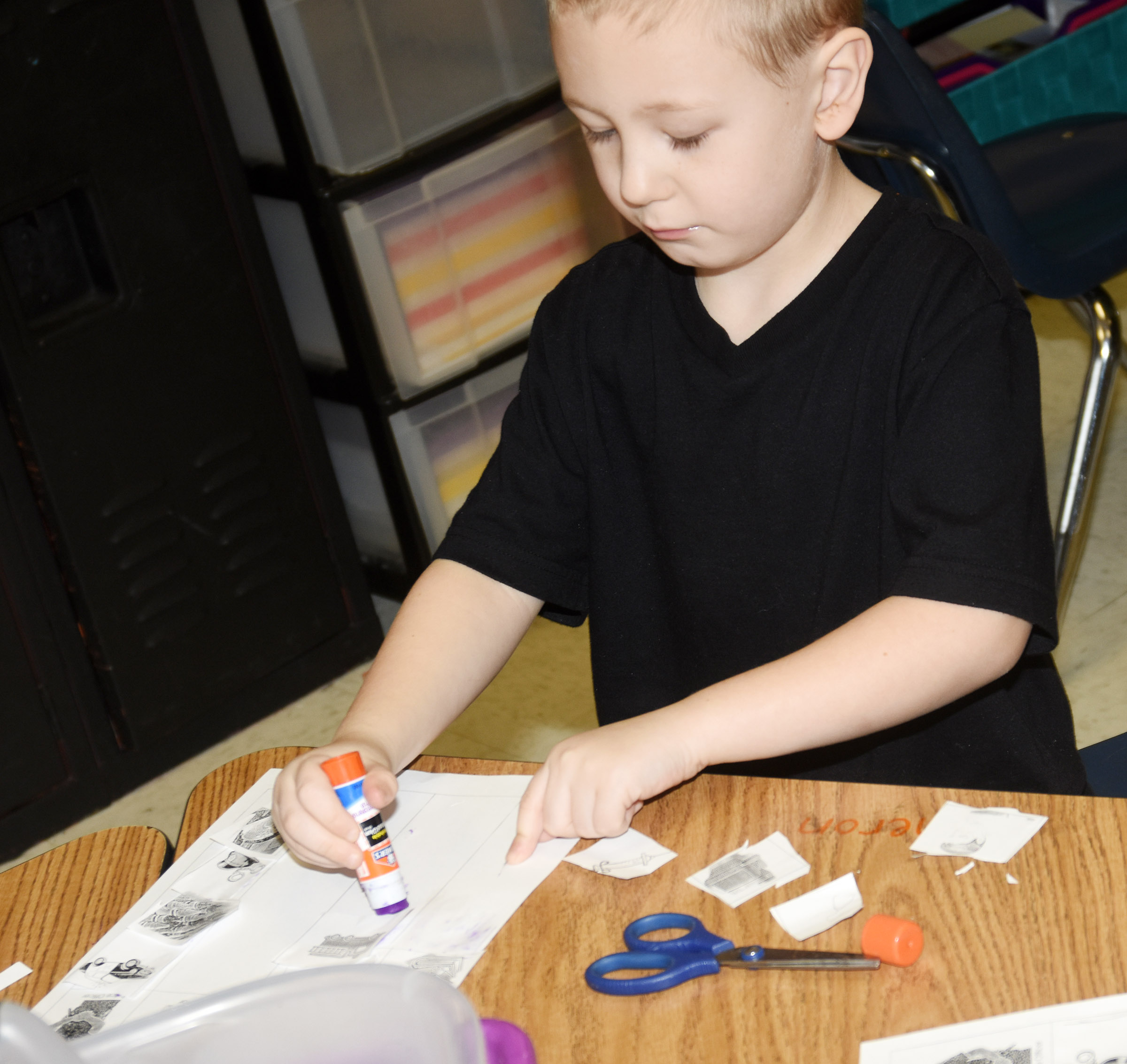 CES kindergartener Cameron Dean matches items that police officers, fire fighters, doctors and teachers use to the correct profession.