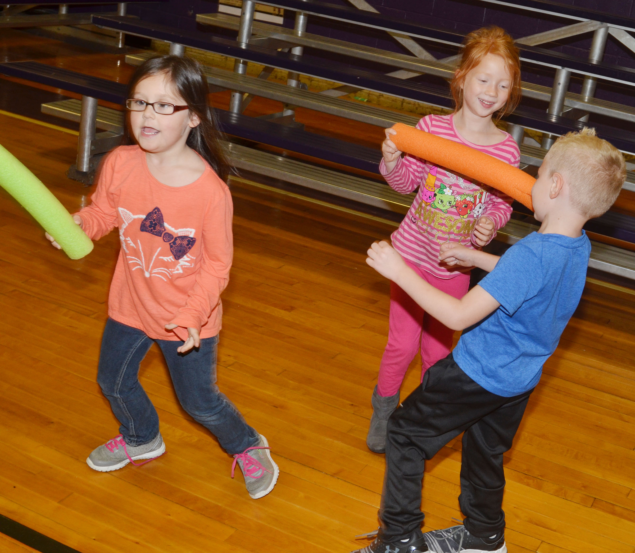 CES kindergarteners, from left, Trinity Clark, Isabella Stout and Jackson Wright play freeze tag.