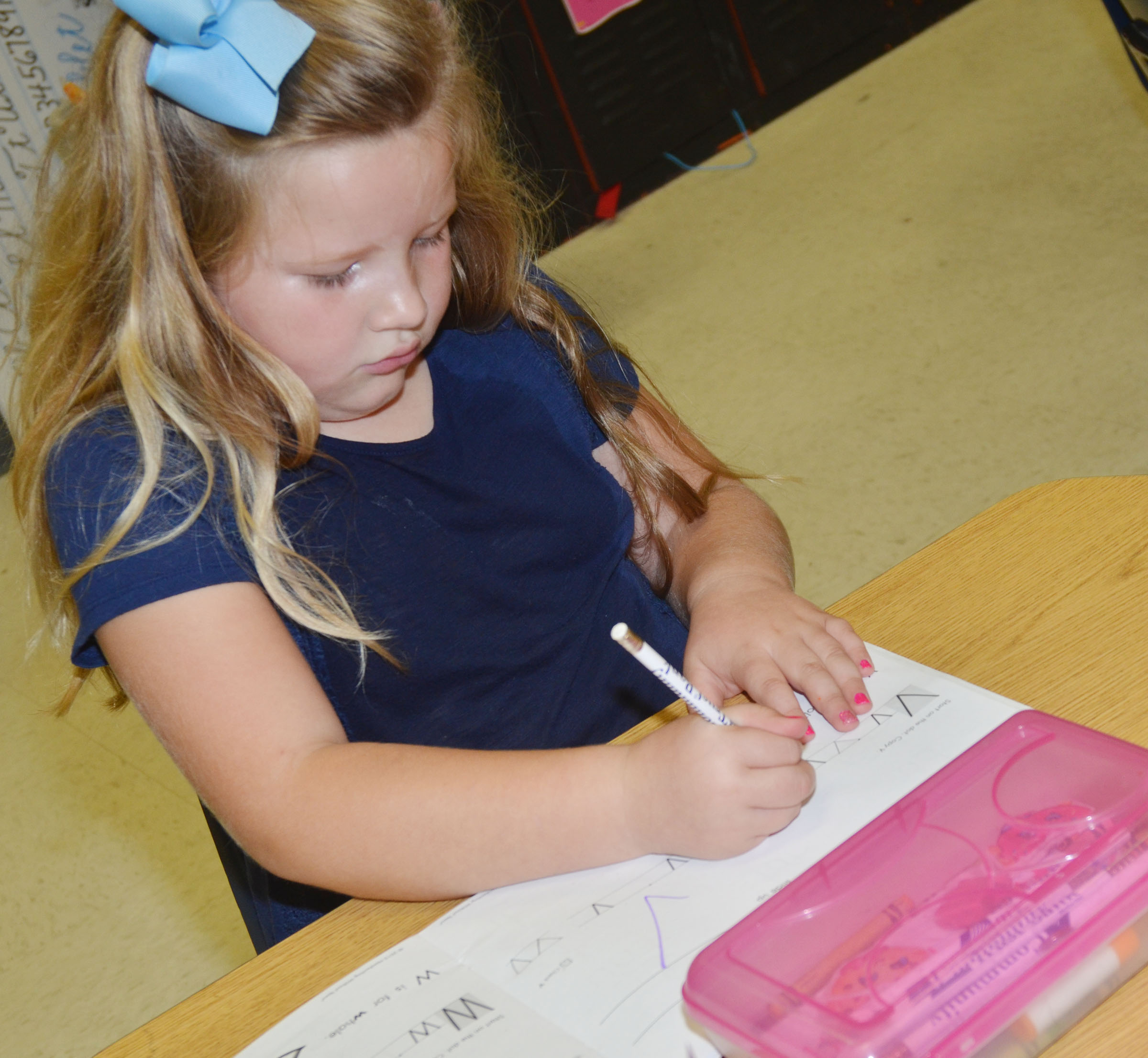CES kindergartener Riley Robison writes the letter V.