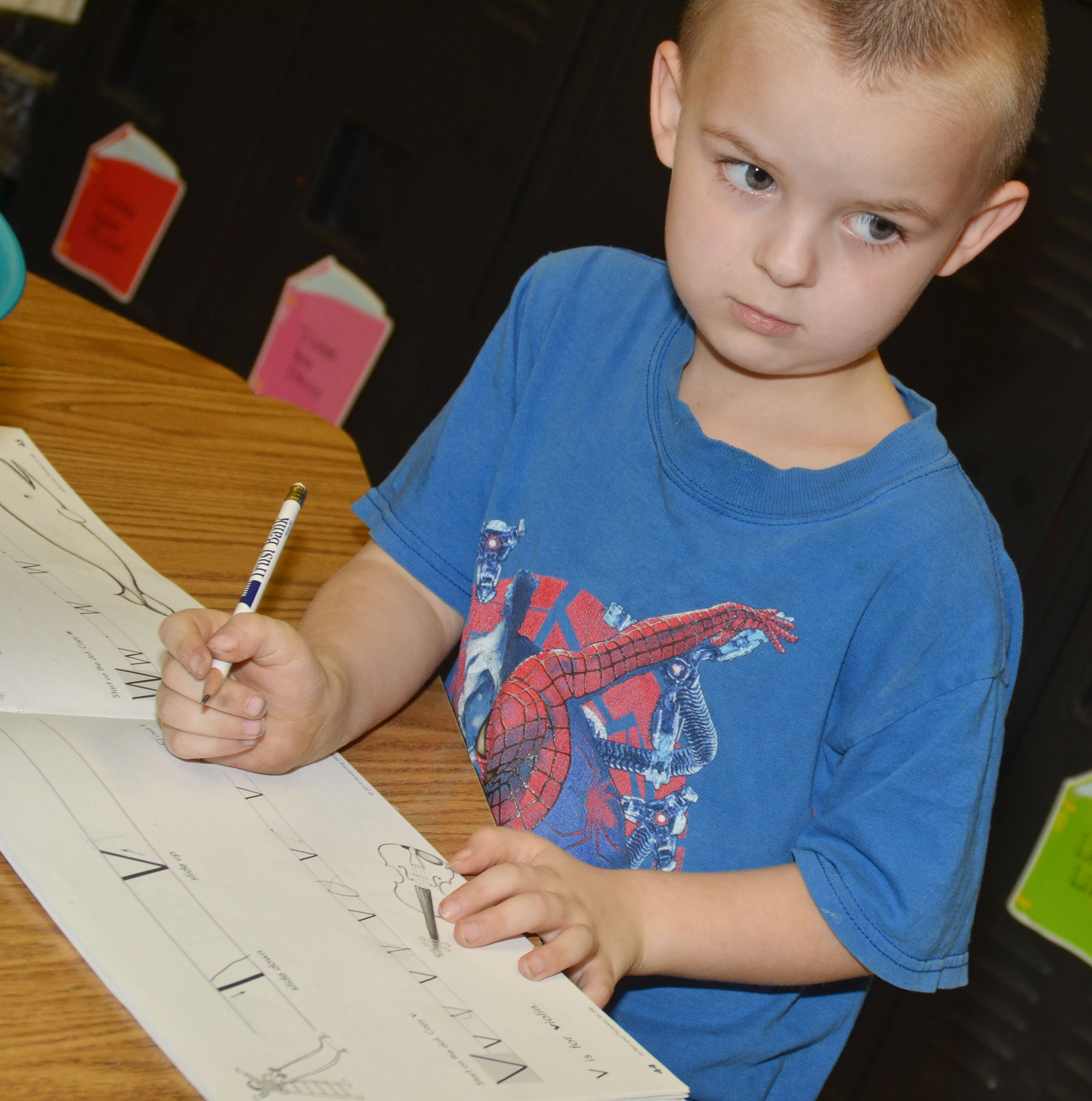 CES kindergartener Raider Callahan writes the letter V.