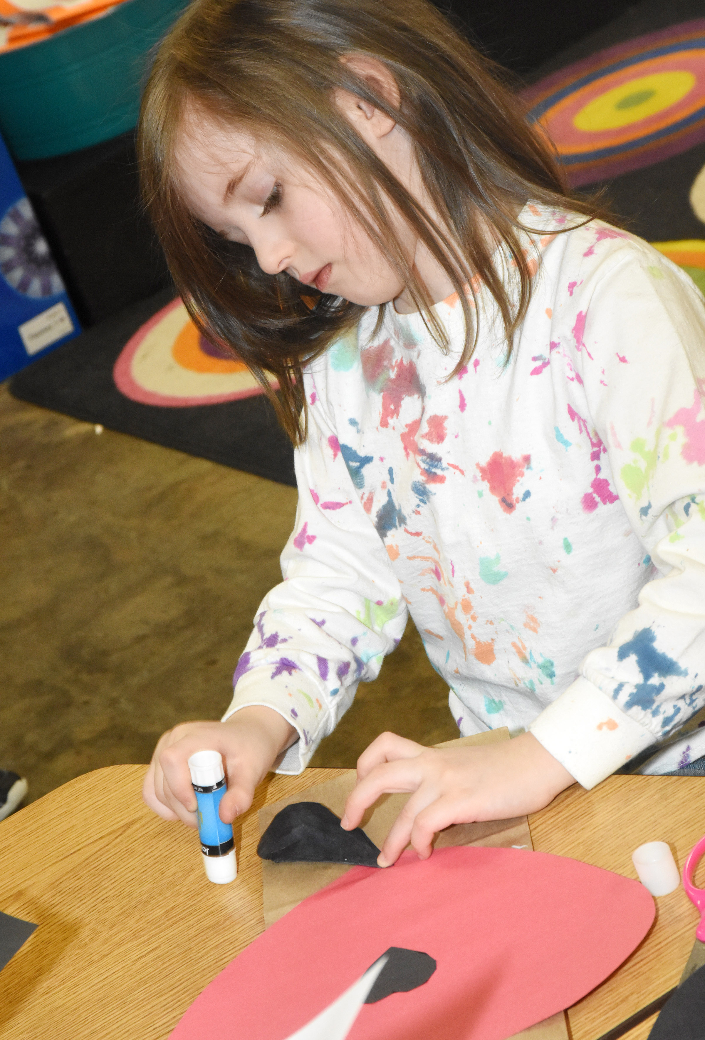 CES kindergartener Lasca Martin glues together her puppy dog Valentine bag.