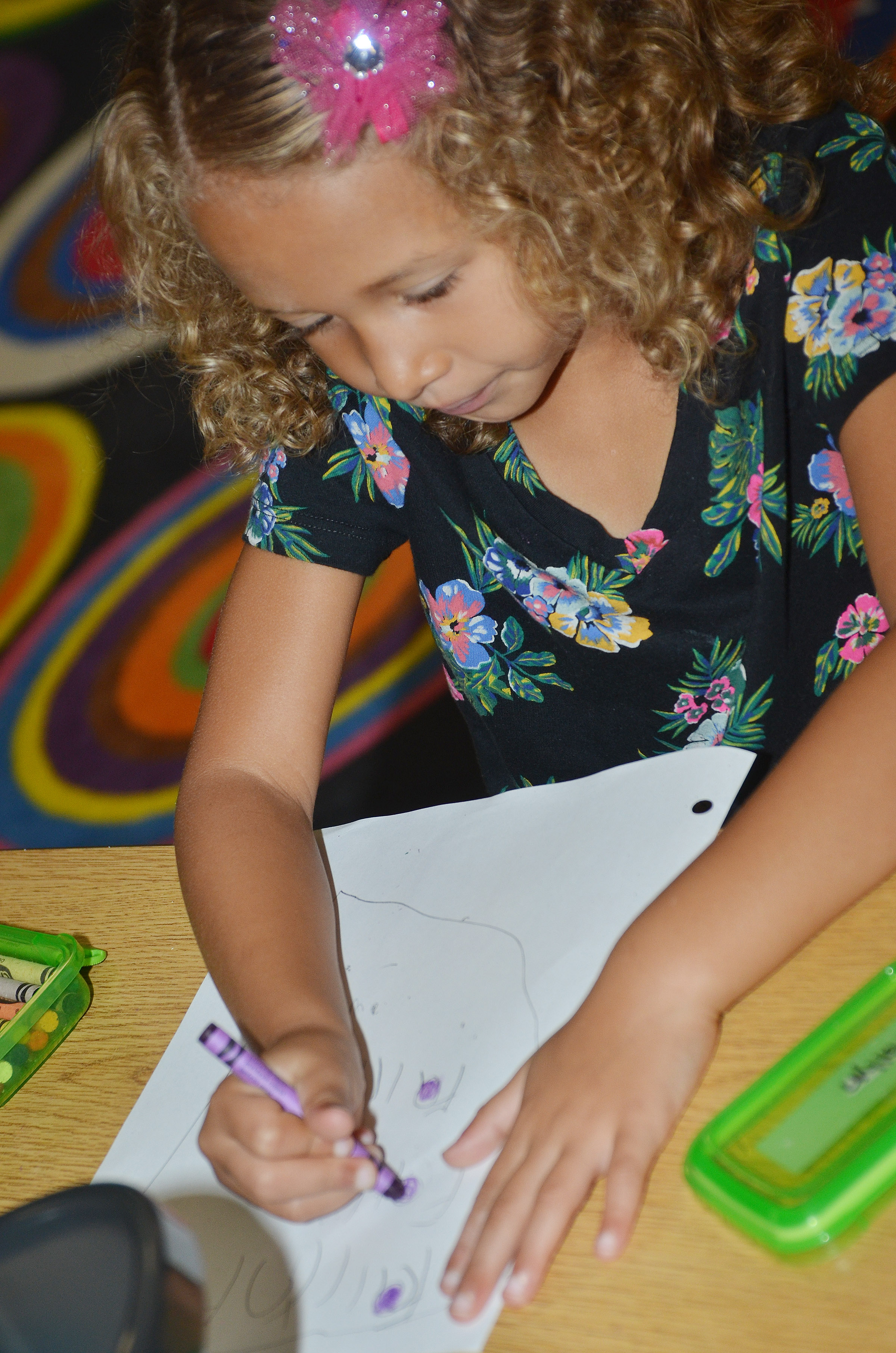 CES kindergartener Fallyn Smith writes her name after finishing her worksheet.
