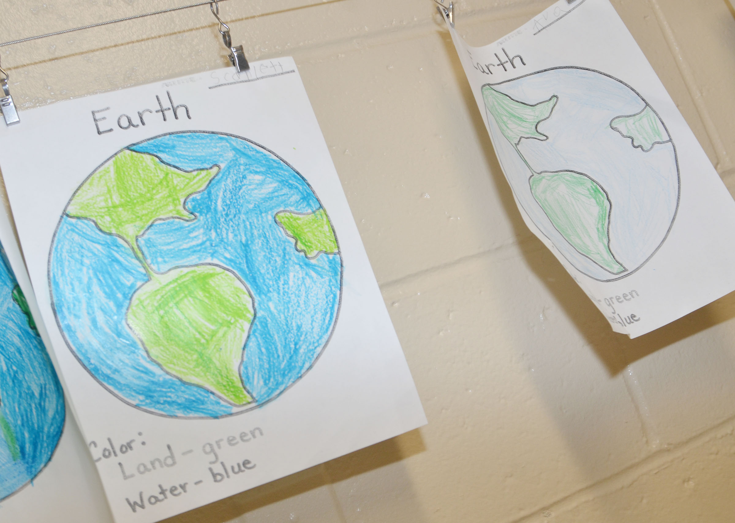 CES kindergarteners colored these pictures of the Earth as they learned about why it's important to protect the planet.
