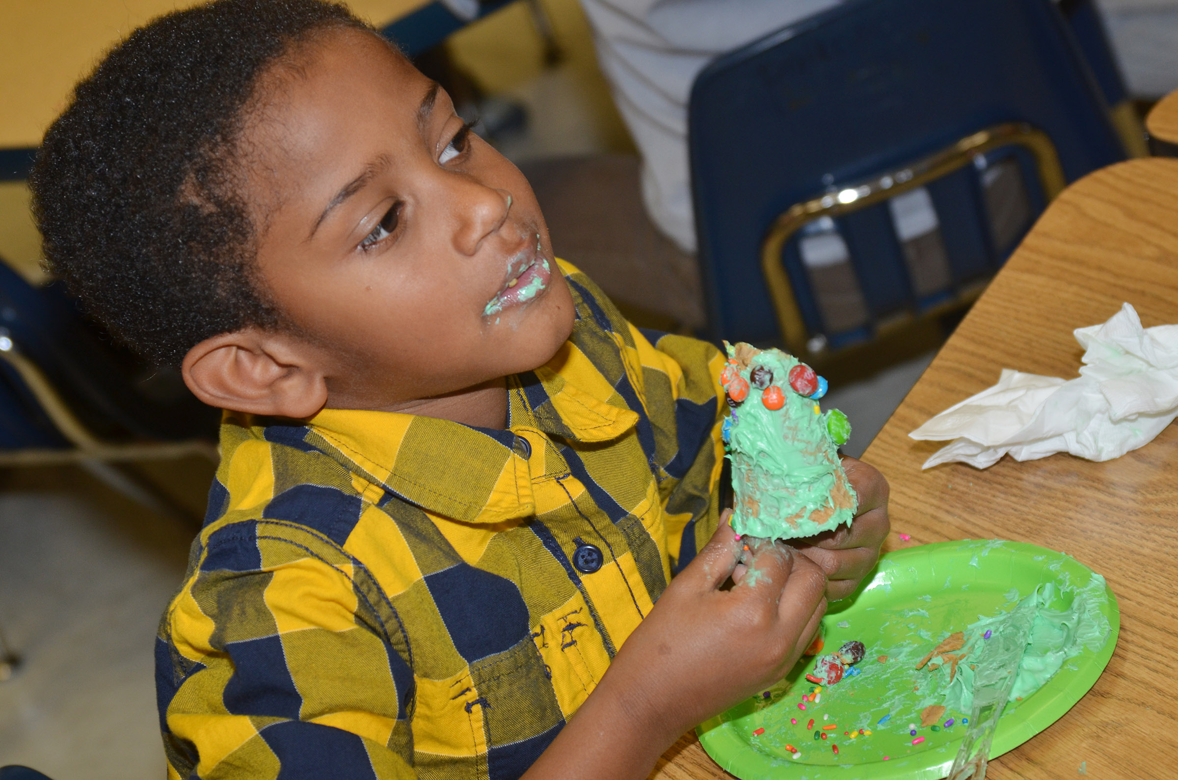 CES kindergartener Kasen Smith takes a bite of his Christmas tree.