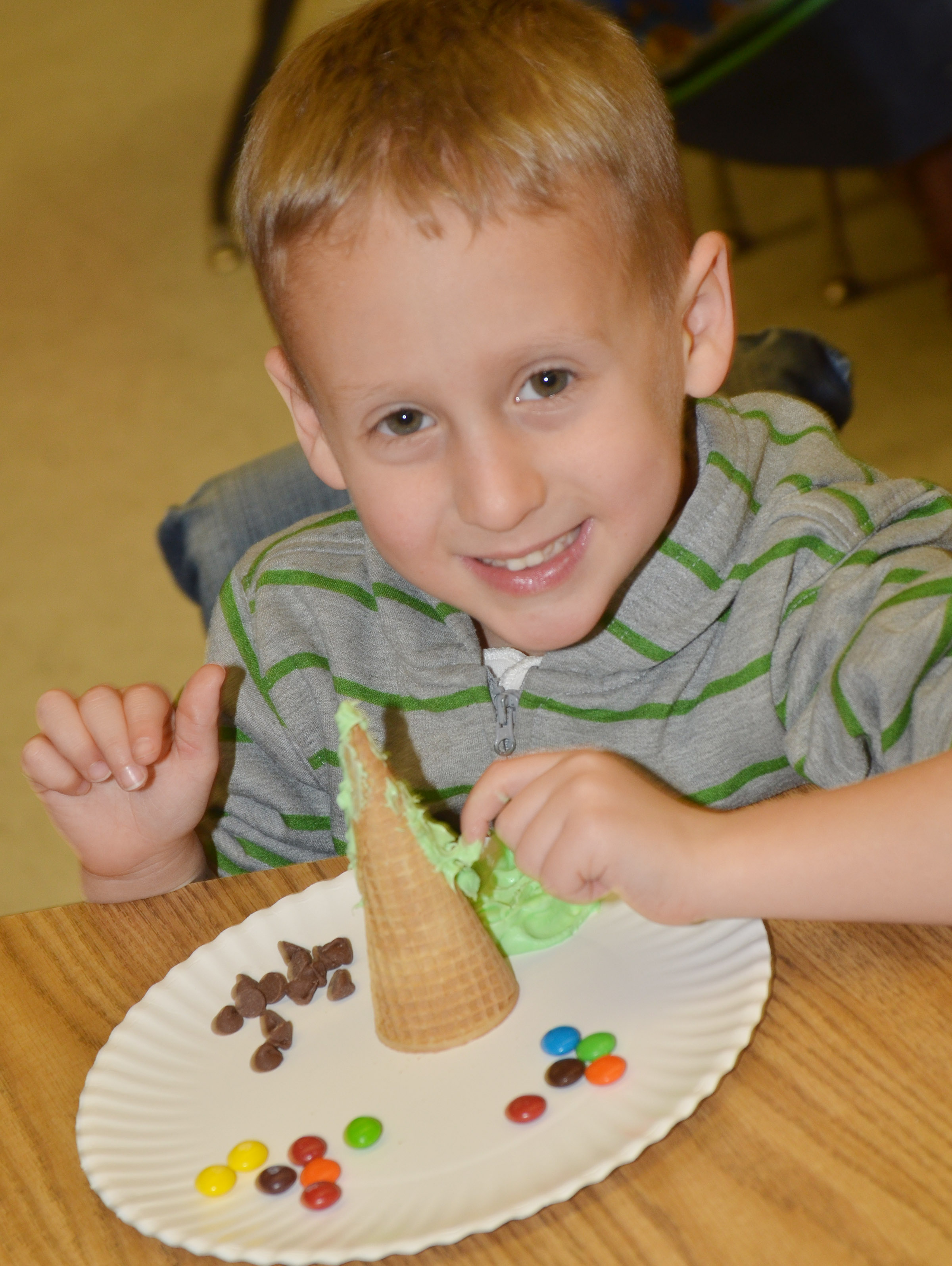 CES kindergartener Gavin Paris adds icing to his Christmas tree.
