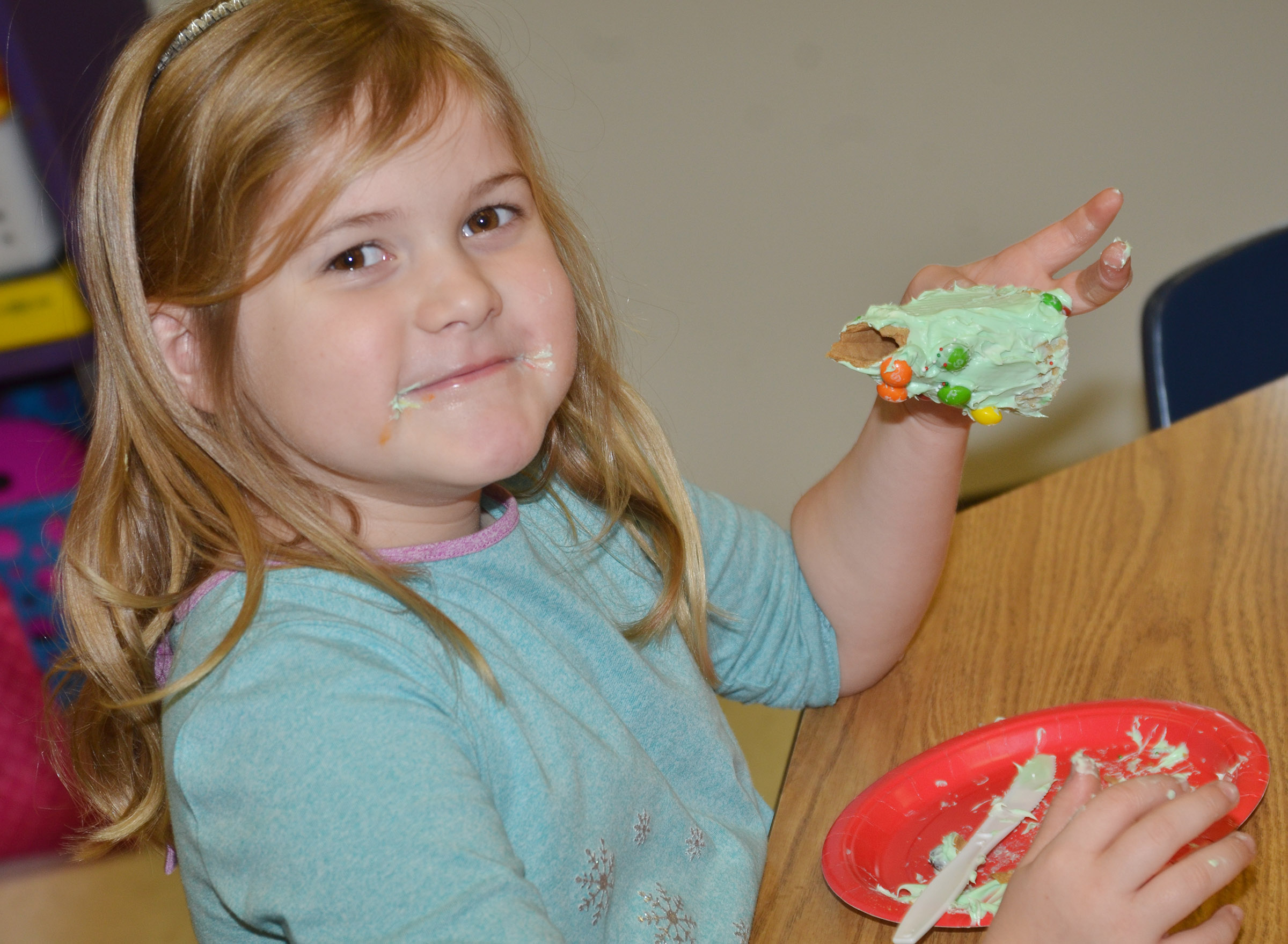 CES kindergartener Aubreigh Knifley enjoys her Christmas tree.